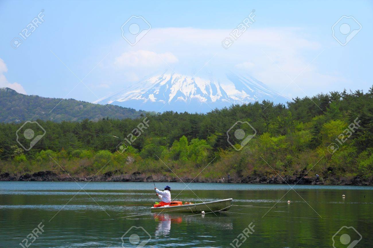 Japan landscape with Mount Fuji - Lake Saiko fisherman and the famous volcano. Part of Fuji Five Lakes in Fuji-Hakone-Izu National Park Stock Photo - 13909766
