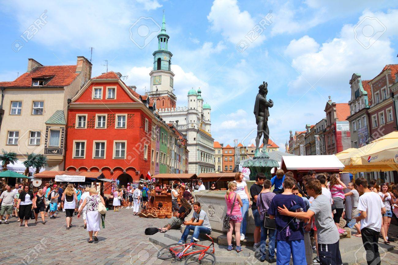 POZNAN, POLAND - JUNE 7: Tourists visit the main square on June 7, 2011 in Poznan, Poland. With 1.7m visitors (2006 data) Poznan is the 3rd most visited city in Poland. Stock Photo - 14466945
