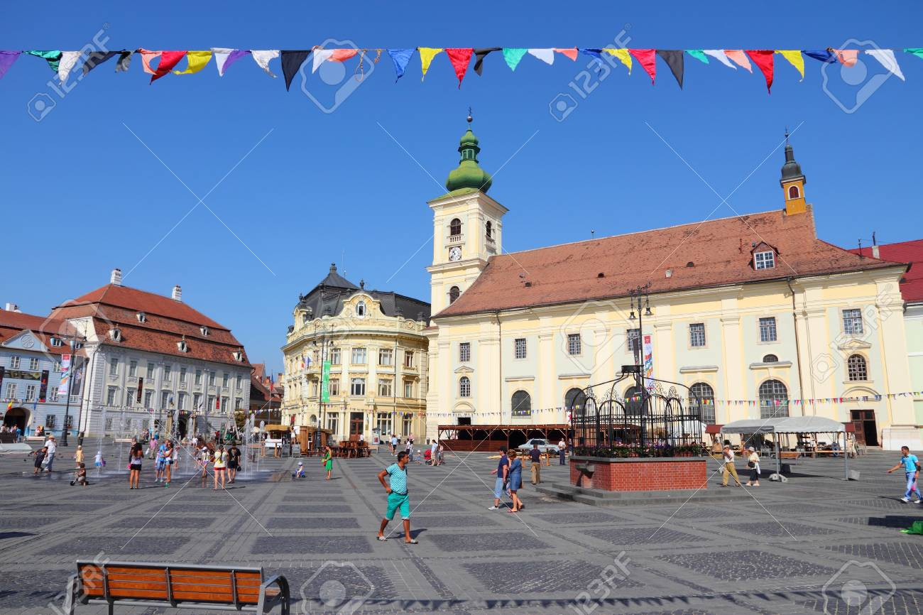 SIBIU, ROMANIA - AUGUST 24: Tourists visit main square on August 24, 2012 in Sibiu, Romania. Sibiu's tourism is growing with 284,513 museum visitors in 2001 and 879,486 visitors in 2009. Stock Photo - 15453002
