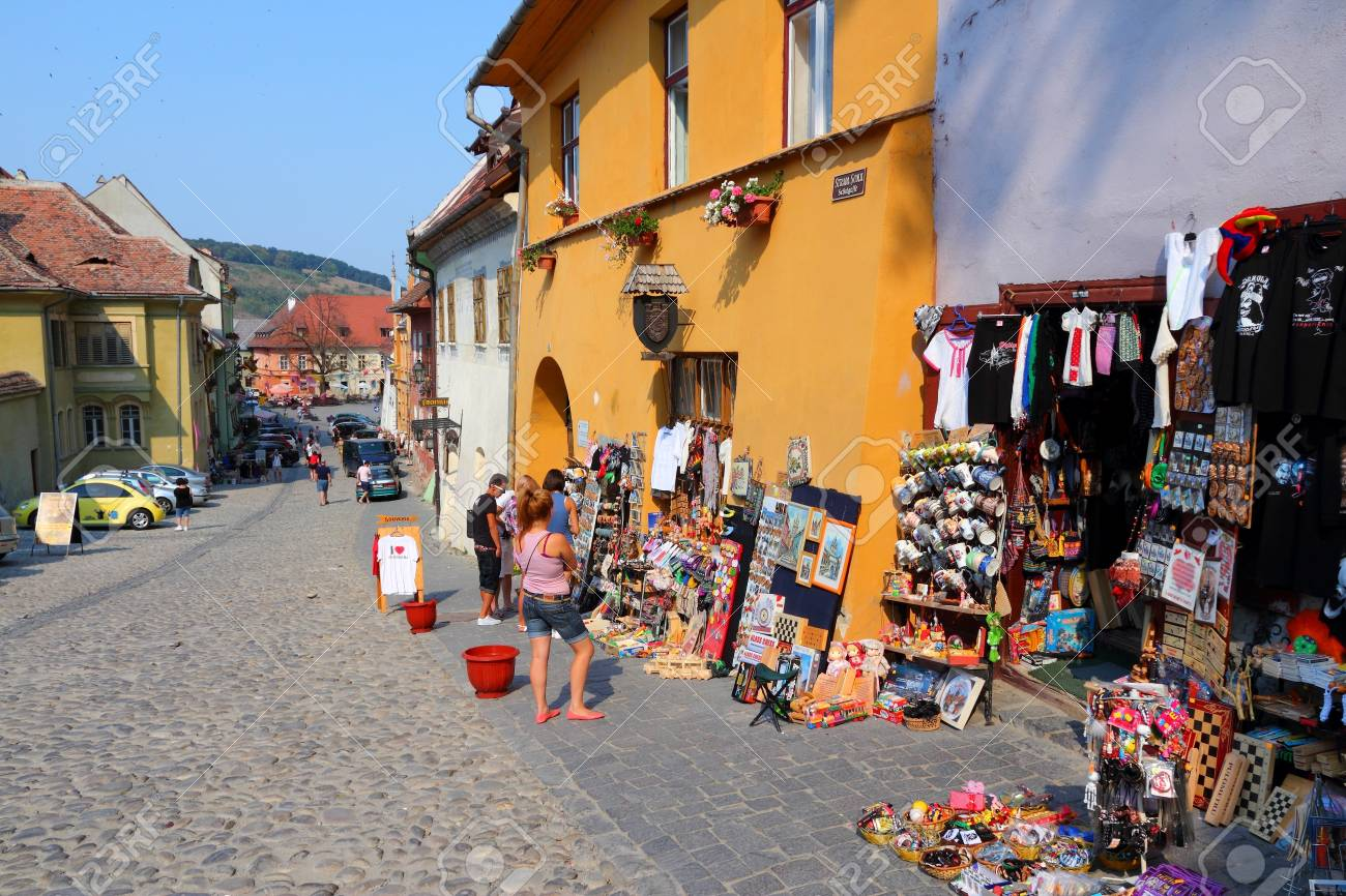 SIGHISOARA, ROMANIA - AUGUST 25: People visit old town on August 25, 2012 in Sighisoara, Romania. Sighisoara is a UNESCO World Heritage Site and a popular tourism destination. Stock Photo - 17356029