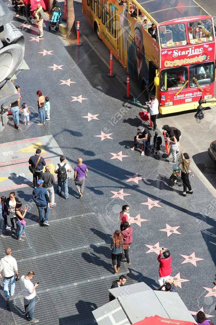 LOS ANGELES, USA - APRIL 5, 2014: People walk famous Walk of