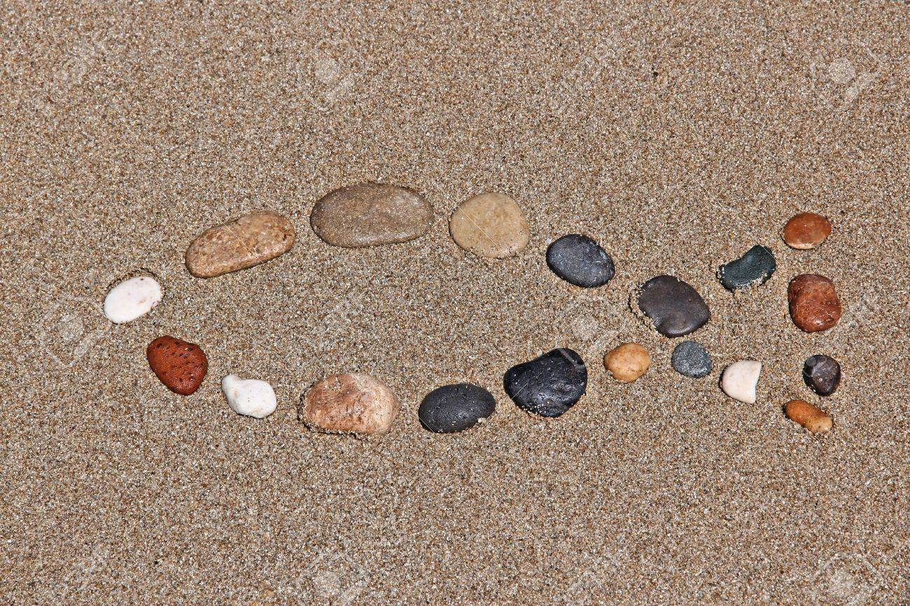 Christianity symbol religious shape made of pebbles catholicism christianity symbol religious shape made of pebbles catholicism fish ichthus stock photo biocorpaavc Image collections