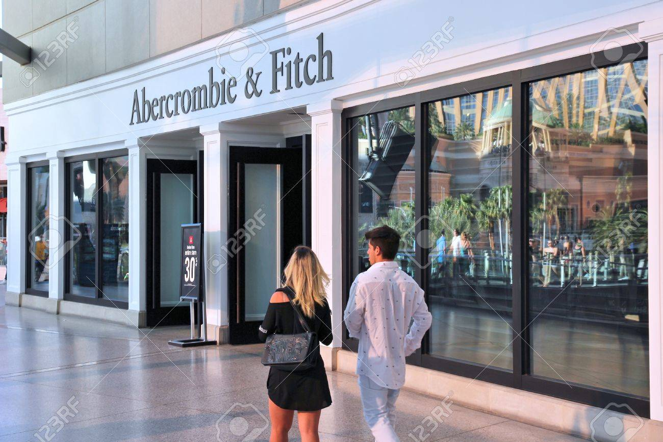 LAS VEGAS, USA - APRIL 14, 2014: People walk by Abercrombie and Fitch store in Las Vegas. Abercrombie and Fitch dates back to 1892 and had 1006 locations as of 2014. - 33362347