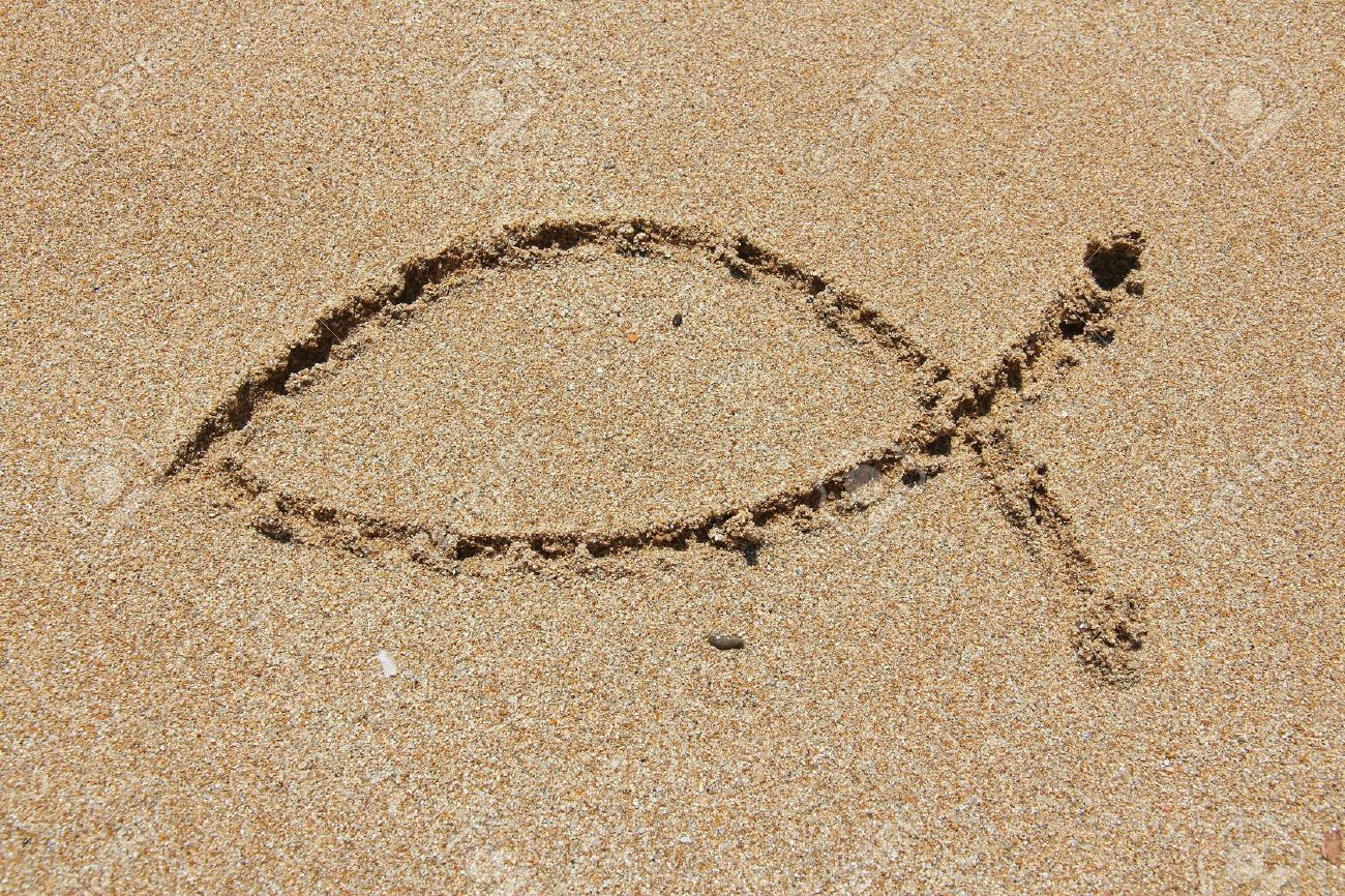 Christianity symbol religious shape drawn in sand catholicism christianity symbol religious shape drawn in sand catholicism fish ichthus stock photo biocorpaavc Image collections