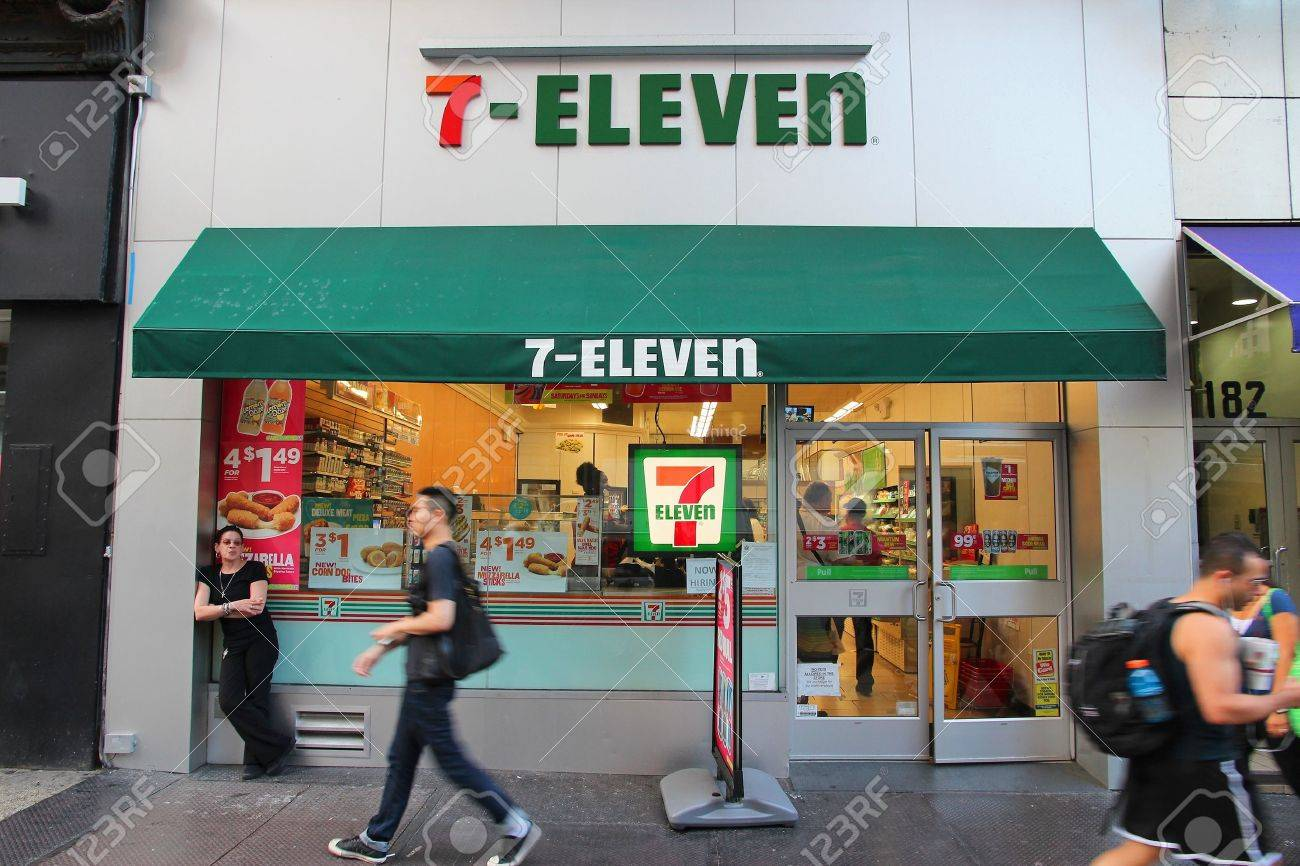 NEW YORK, USA - JULY 3, 2013: People walk past 7-Eleven convenience store in New York. 7-Eleven is world's largest operator, franchisor and licensor of convenience stores, with more than 46,000 shops. - 36654360