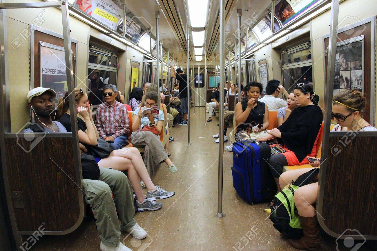 NEW YORK, USA - JULY 4, 2013: People ride Subway train in New York. With 1.67 billion annual rides, New York City Subway is the 7th busiest metro system in the world. - 37610095