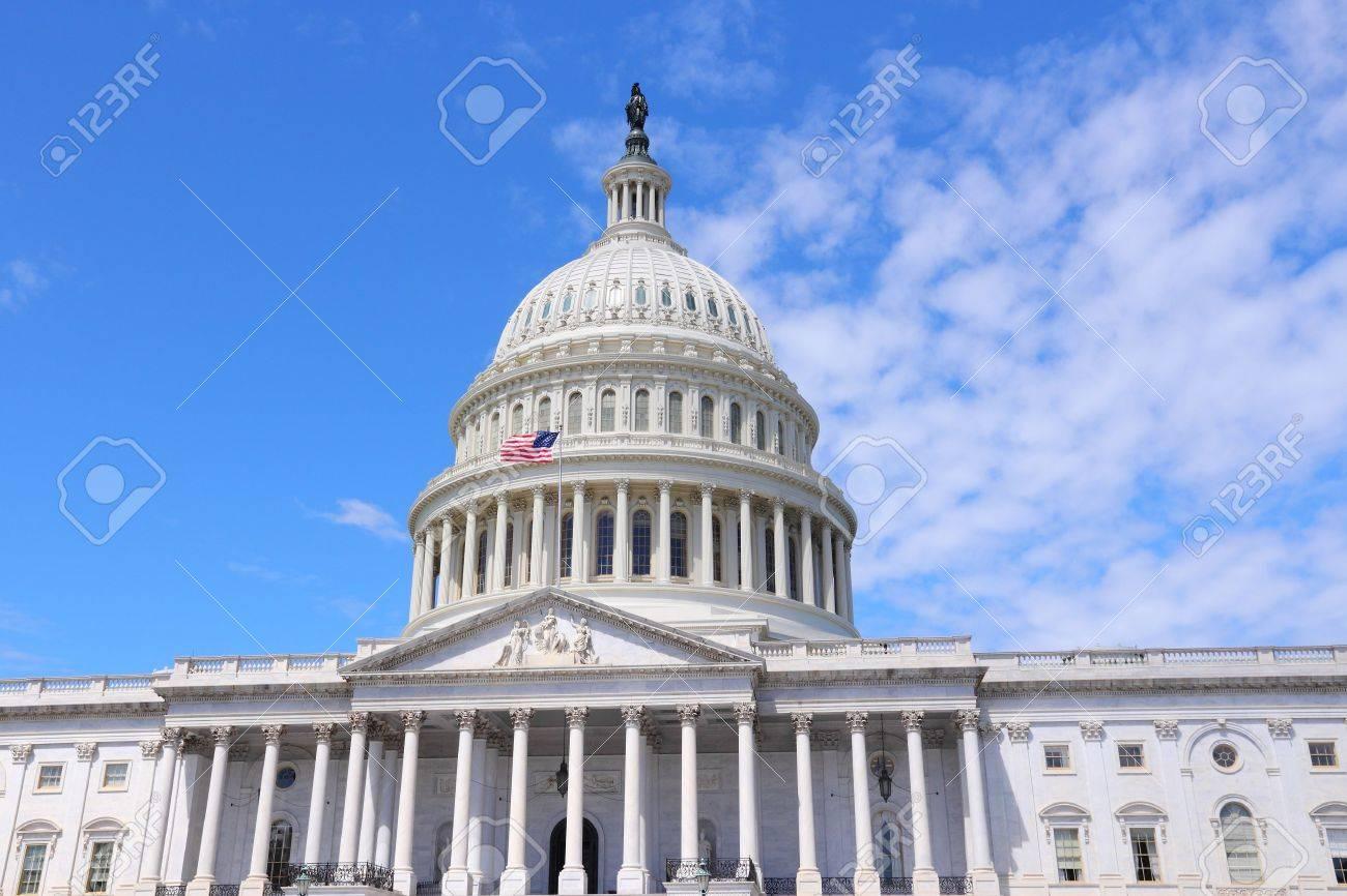 Washington DC, United States landmark. National Capitol building with US flag. - 38000541