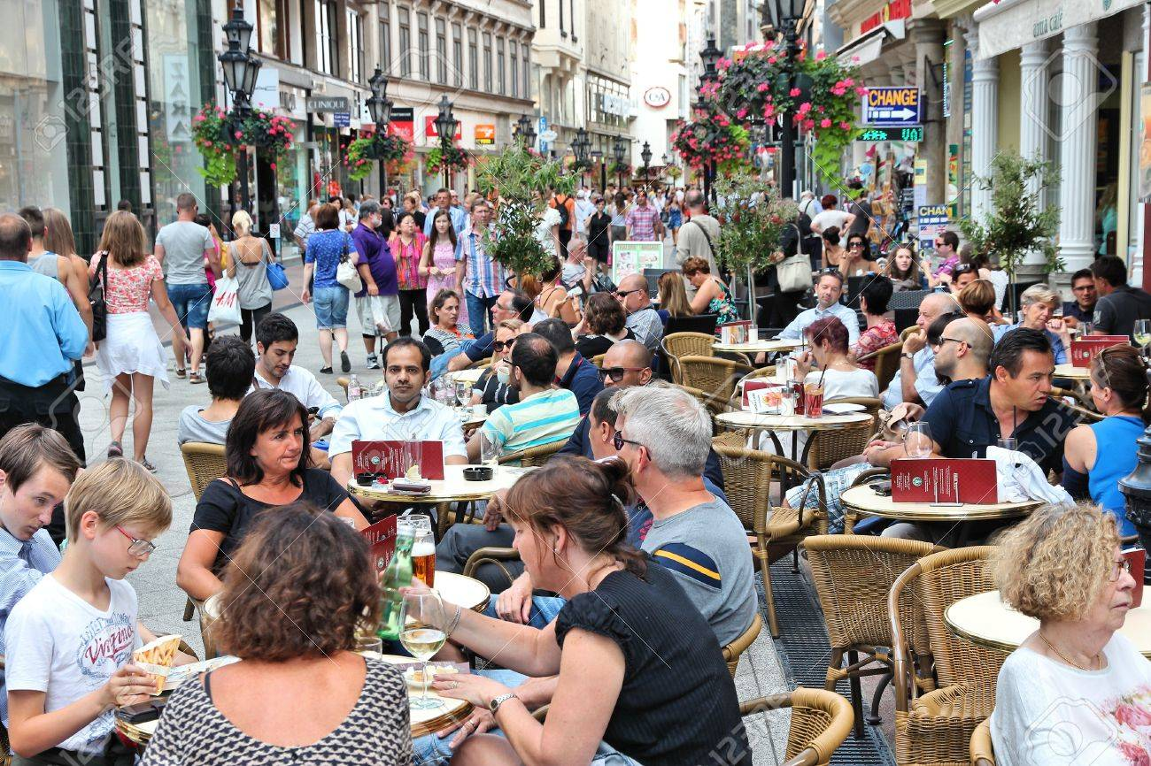 BUDAPEST, HUNGARY - JUNE 19, 2014: People visit Vaci Street in Budapest. 3.3 million people live in Budapest Metropolitan Area. It is the largest city in Hungary and 9th largest in the EU. - 39860922