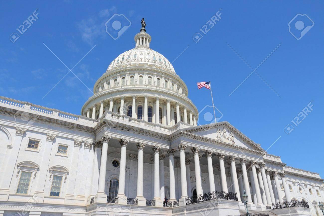Washington DC, United States landmark. National Capitol building with US flag. - 45051914