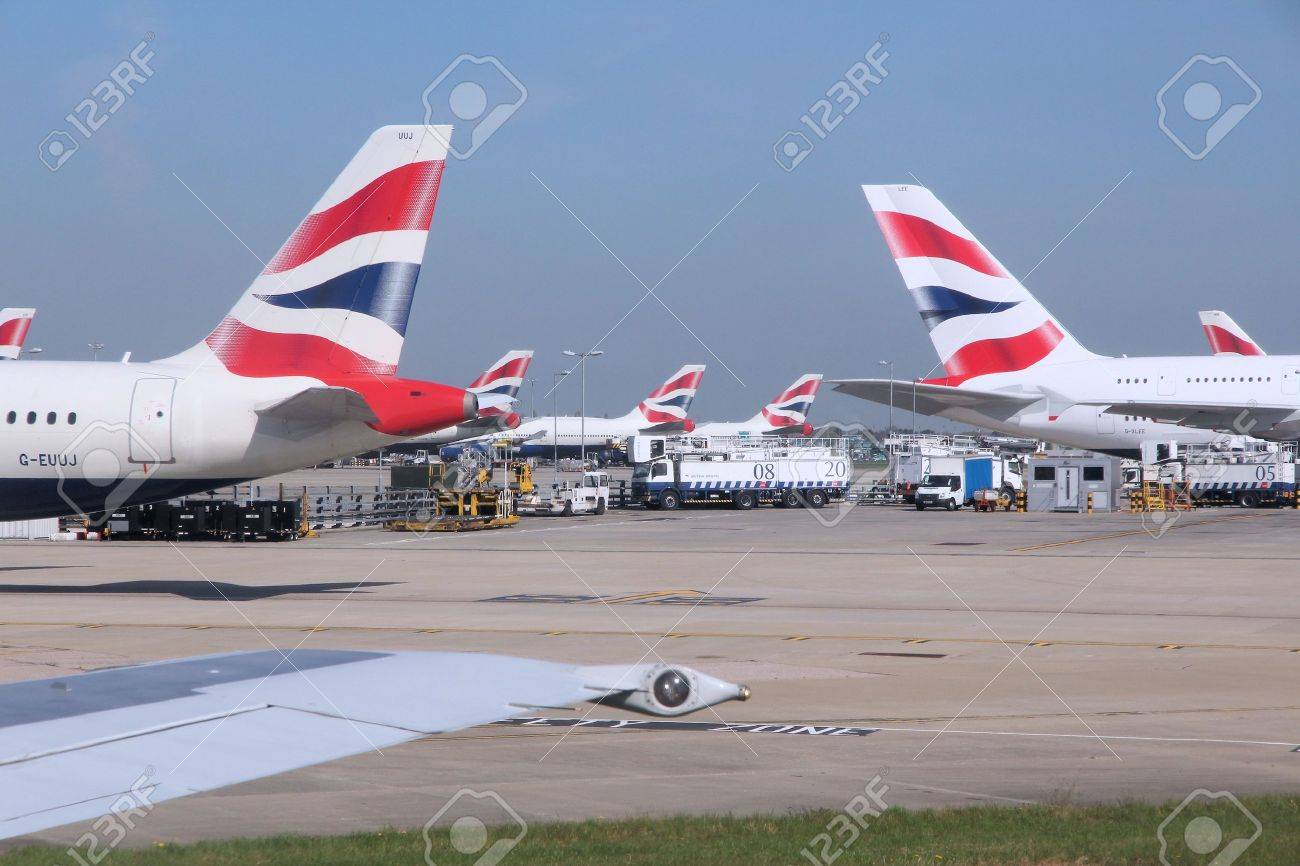 LONDON, UK - APRIL 16, 2014: British Airways Airbus A320s and A380 at London Heathrow airport. BA operates fleet of 283 aircraft (largest in the UK) and is largest operator of 747 with 55 aircraft (2014). - 48400314
