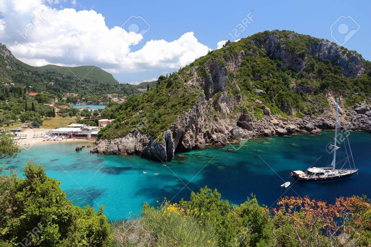 Paleokastritsa on Corfu island, Greece. Ionian Sea coast in summer. - 61042731