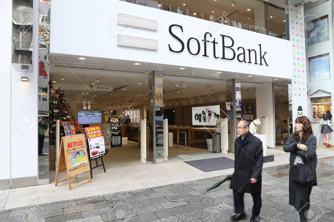 TOKYO, JAPAN - DECEMBER 1, 2016: People walk by SoftBank mobile phone network store in Tokyo, Japan. There are 146.6 million mobile phones in use in Japan (2013). - 78555404
