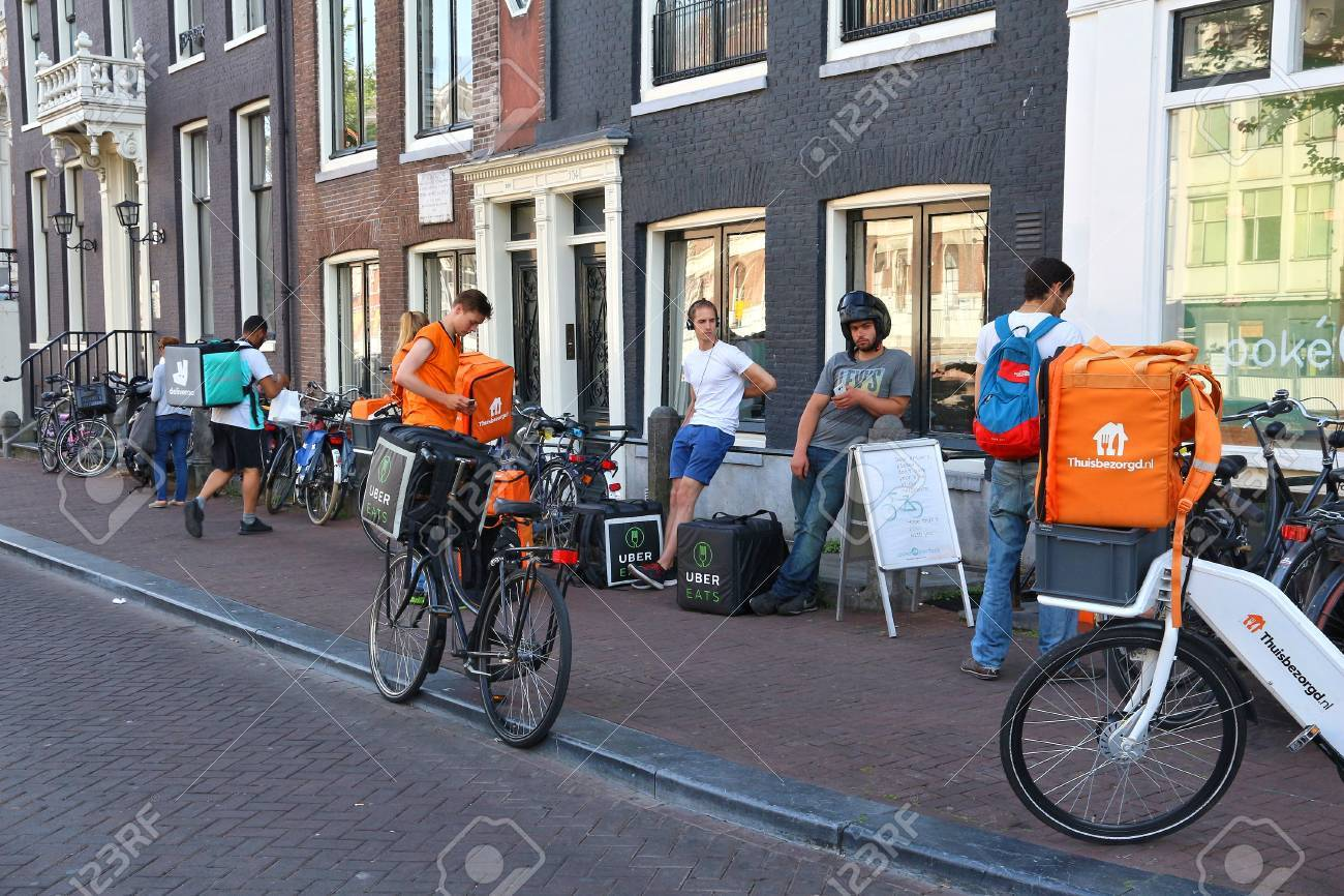 AMSTERDAM, NETHERLANDS - JULY 9, 2017: Uber Eats, Thuisbezorgd