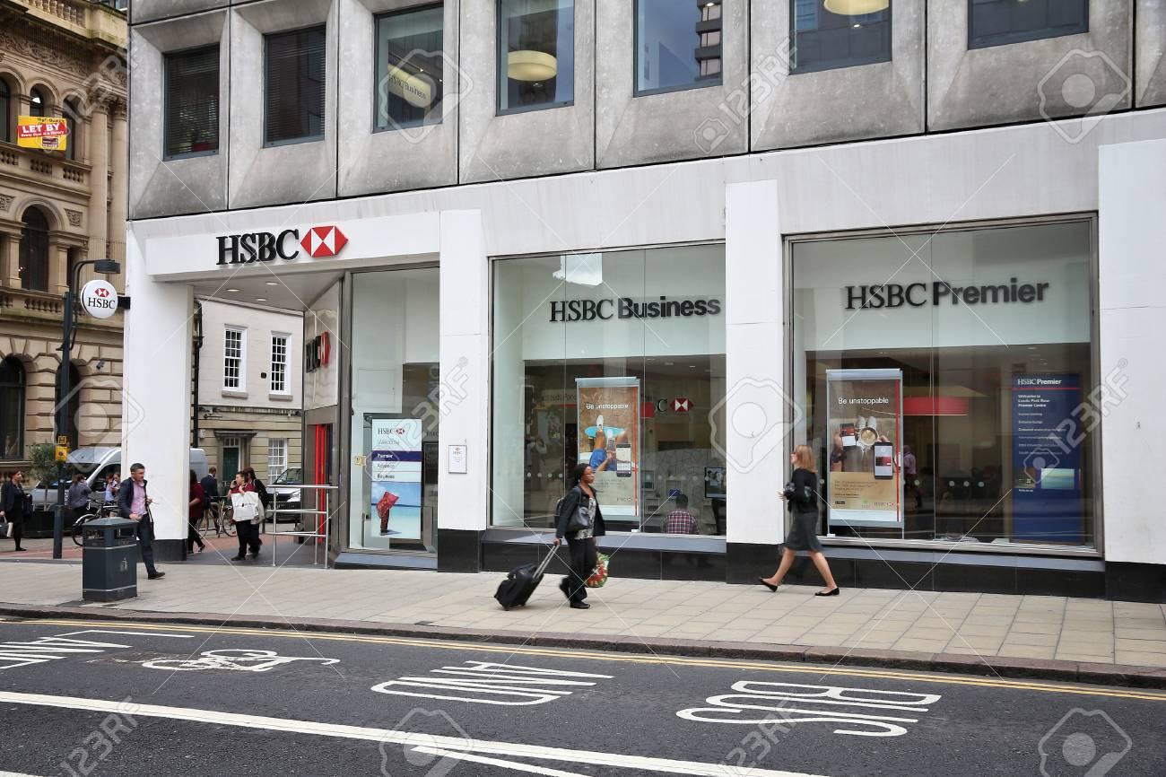 LEEDS, UK - JULY 12, 2016: People walk by HSBC Bank in Leeds,