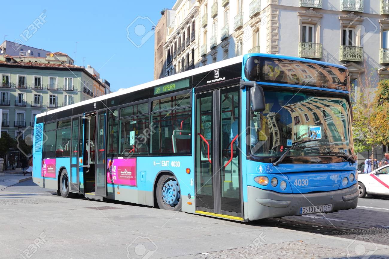 MADRID, SPAIN - OCTOBER 22, 2012: People ride city bus in Madrid. EMT is Madrid's main bus operator. It uses fleet of more than 2000 buses and serves about 450 million rides annually (2011). - 87197973