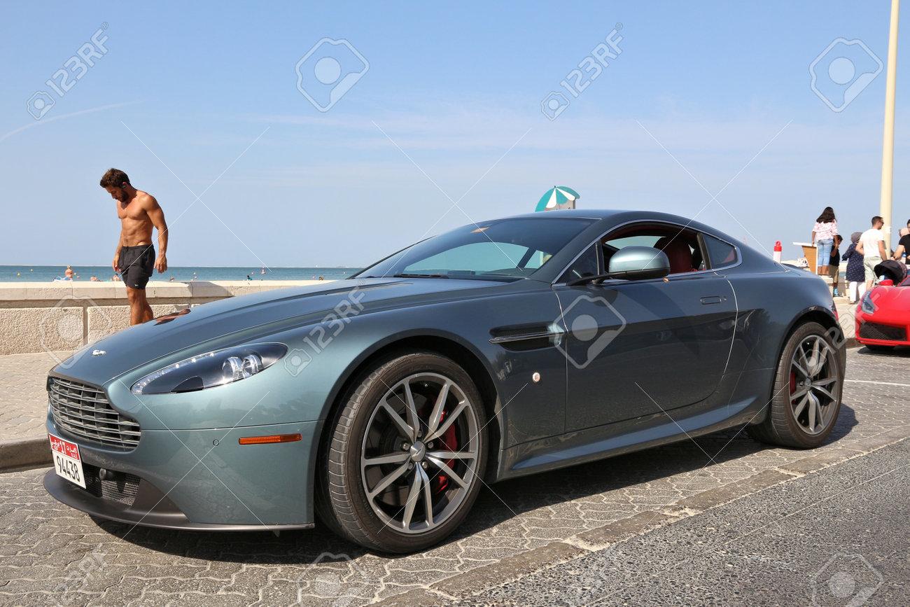 Dubai Uae November 23 2017 Man Walks By Aston Martin Vantage Stock Photo Picture And Royalty Free Image Image 91927830