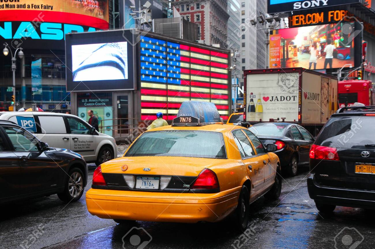 huge selection of 3f18e 2dc25 NEW YORK, USA - JUNE 10, 2013: Yellow cabs drive in rain in Times..
