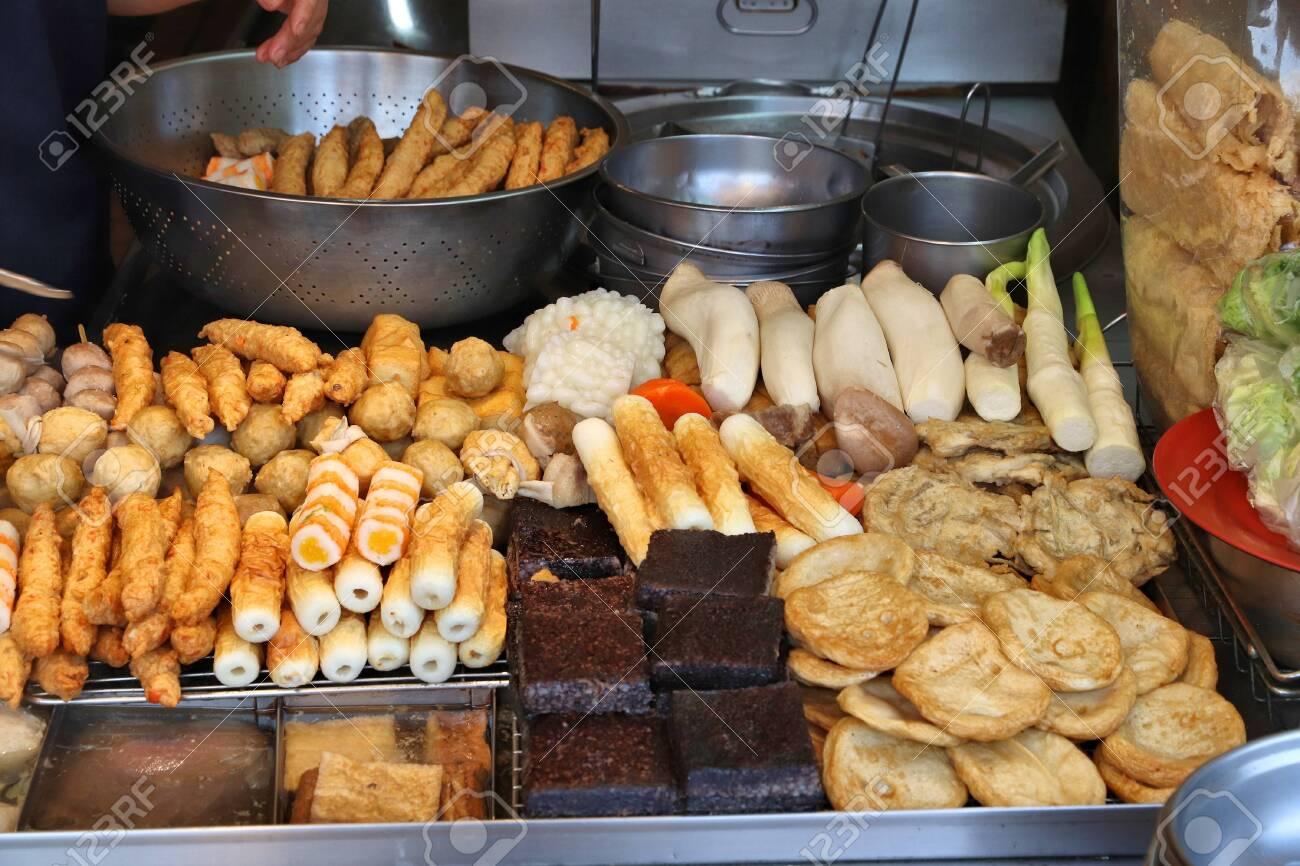 Taiwan night food market - Raohe Night Market in Taipei. Tofu, fish balls and other food - Chinese cuisine. - 138415571