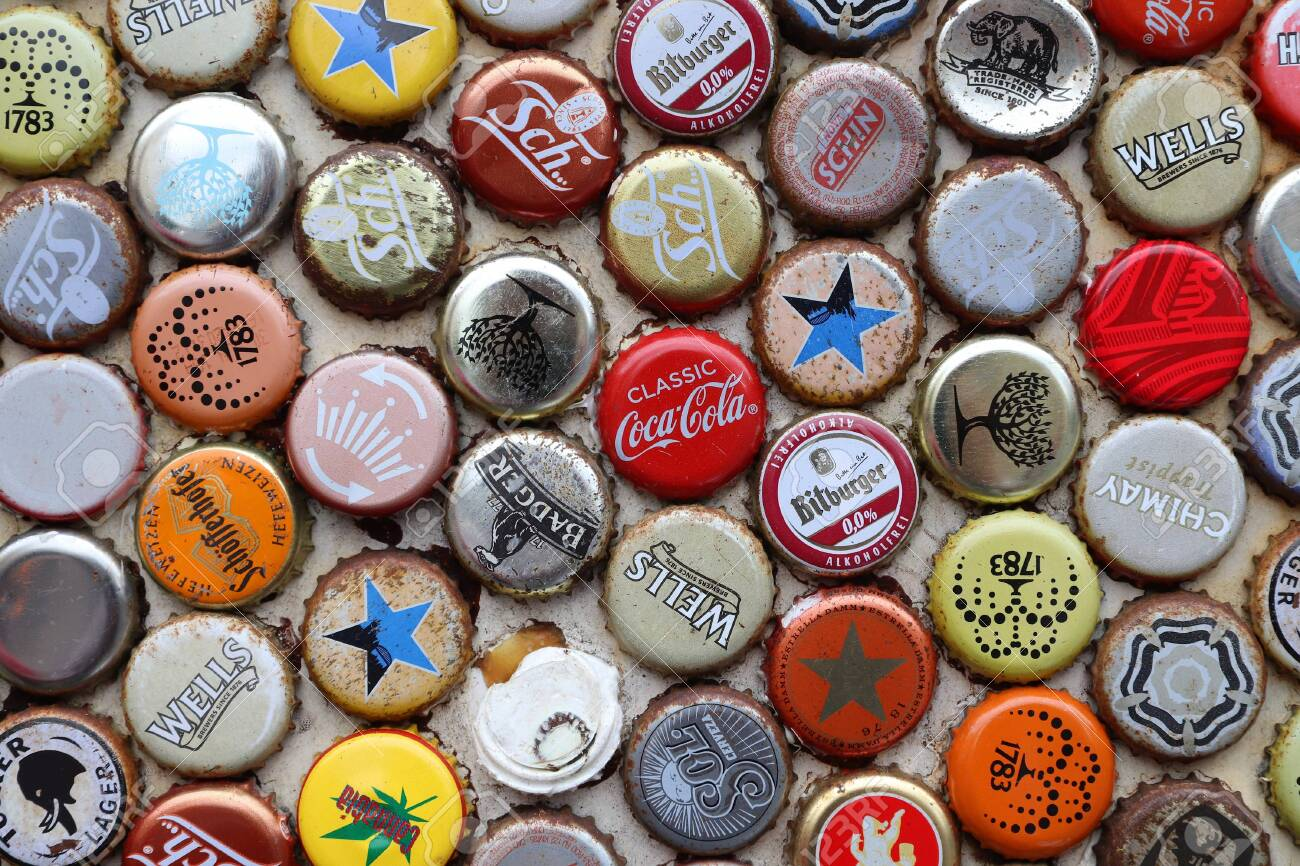 LONDON, UK - JULY 13, 2019: Mixed beer and non alcoholic beverages metal bottle caps in London UK. - 141806416