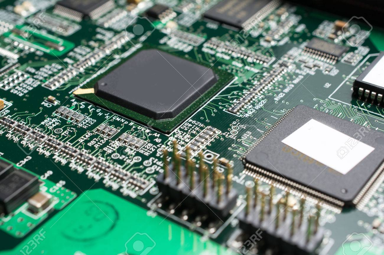 Detail Of An Electronic Printed Circuit Board With Many Electrical Components Stock Photo 66828037