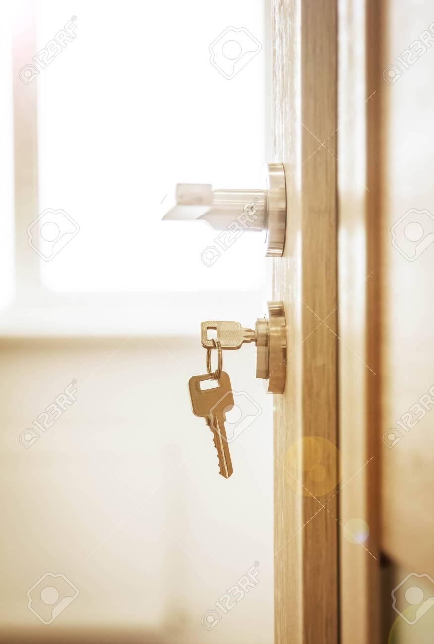 Door lock , door open in front of room blur background - 134793764
