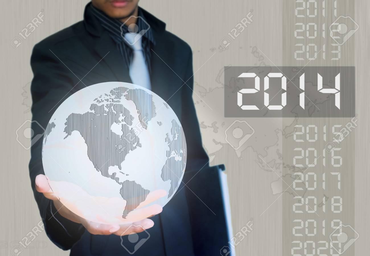silver ball earth in hand businessman 2014 year - 22019952
