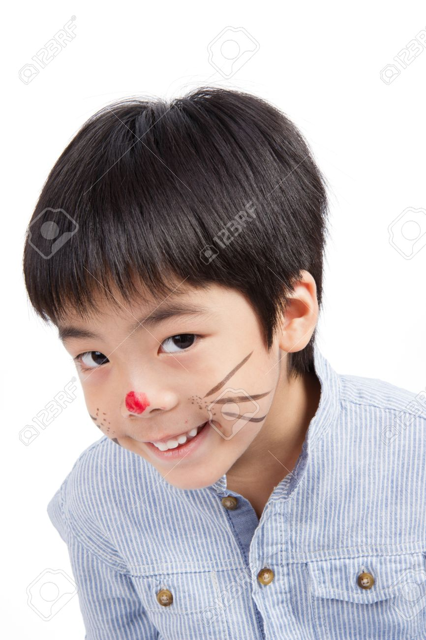 cute boy painting his face smiling isolated on white background Stock Photo - 21404926