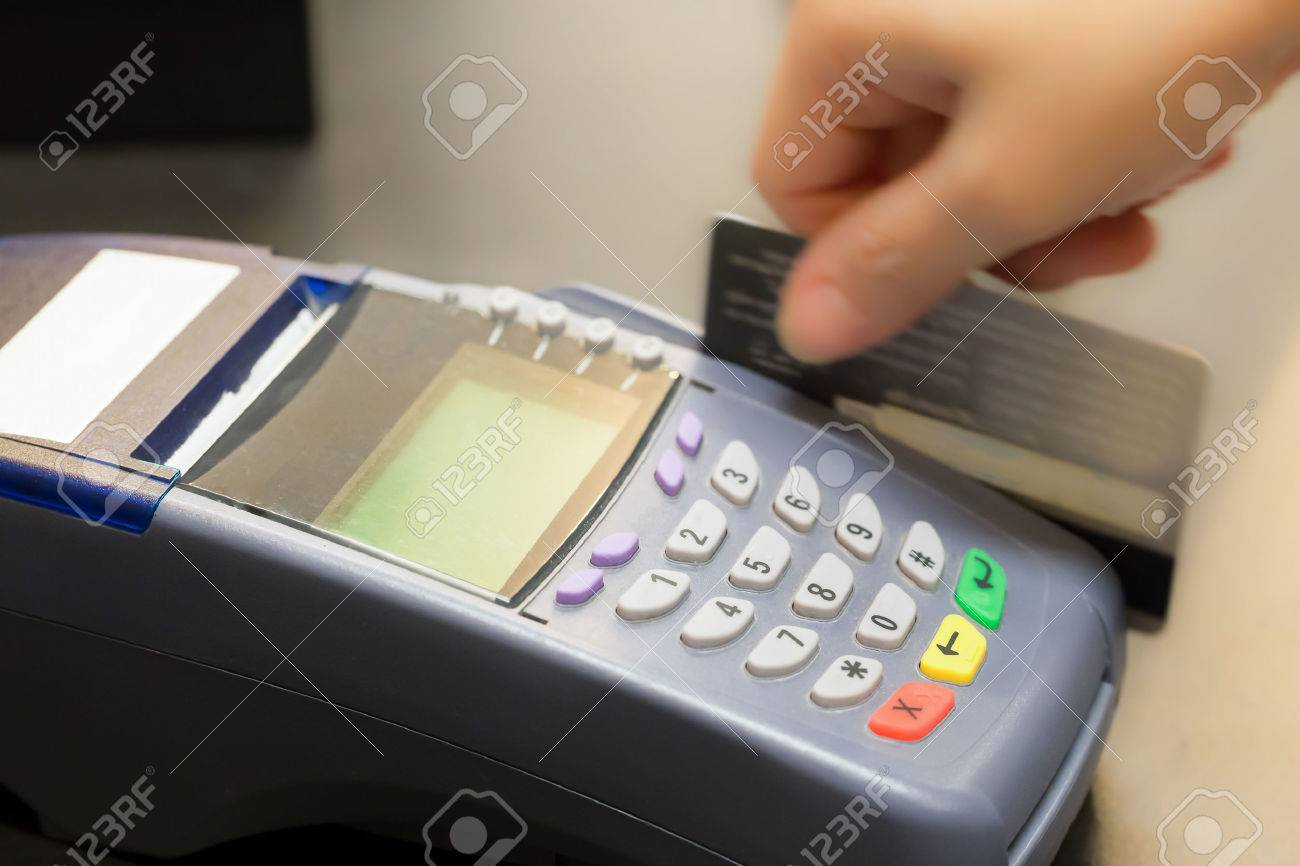Hand Swiping Credit Card In Store Stock Photo, Picture And Royalty ...