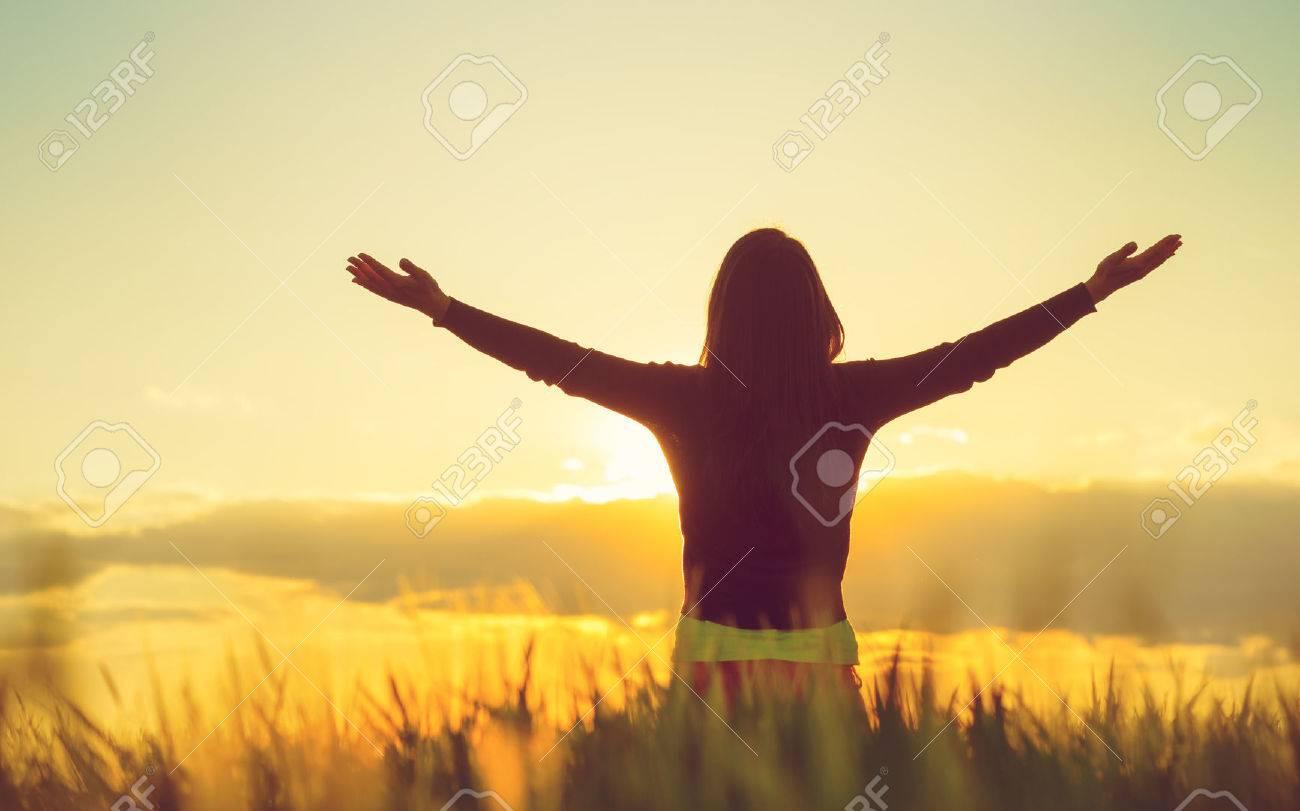 Woman feeling free in a beautiful natural setting. - 59196083