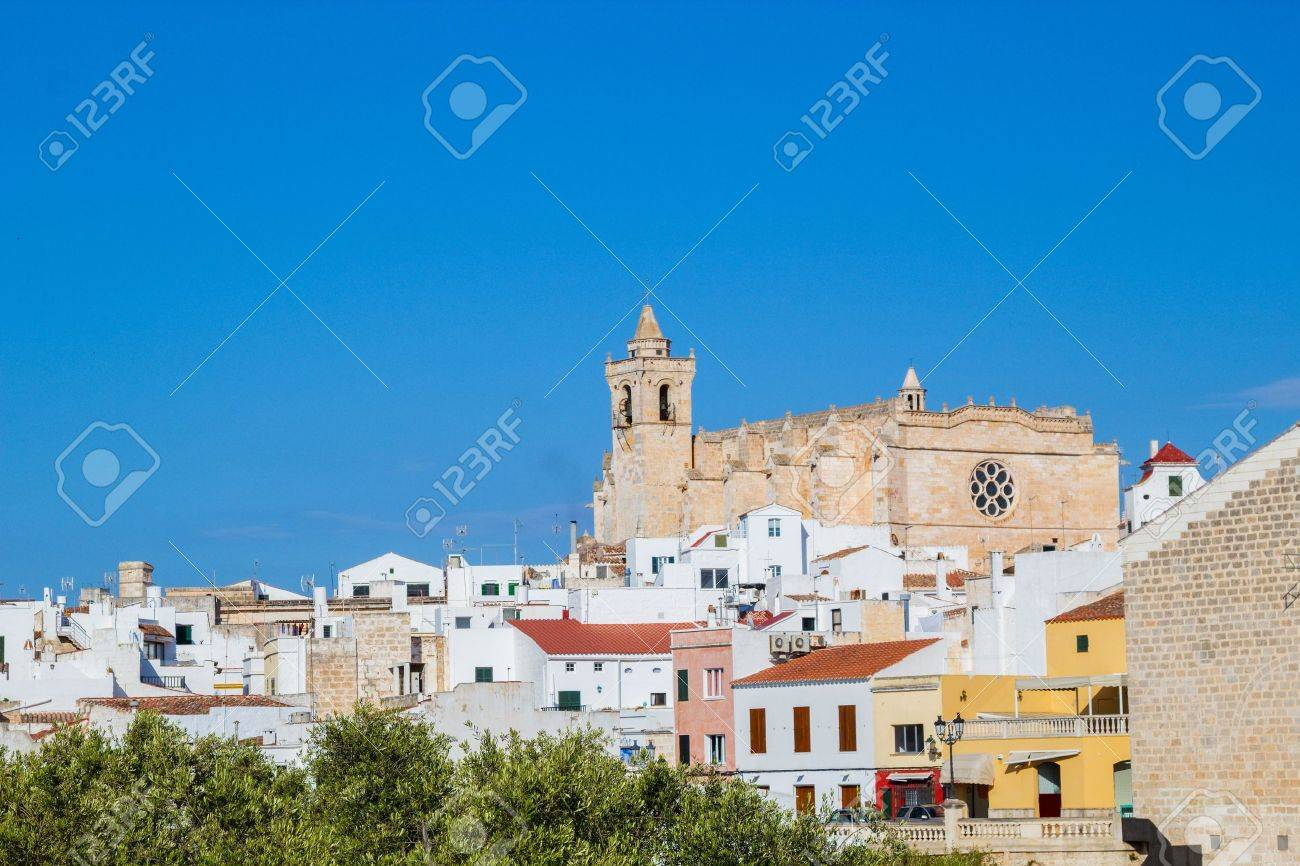 Cityscape of  Ciutadella old town with old cathedral domination, Menorca, Spain  The Cathedral was built in the Catalan Gothic style in 1300-1362, Menorca, Spain Stock Photo - 21394825