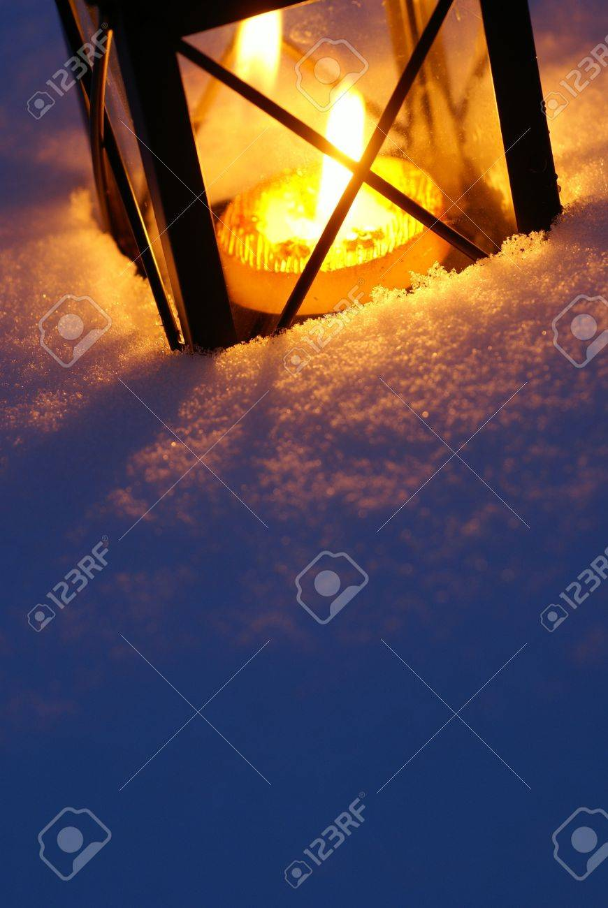 Lantern with burning candle on snow Stock Photo - 21730745