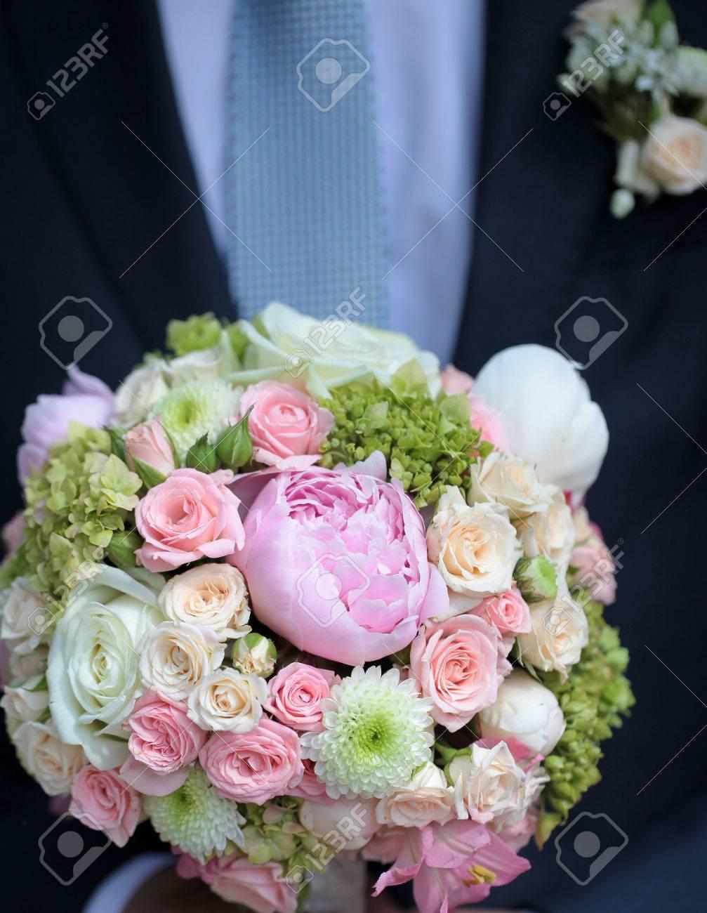 Bridegroom holding beautiful fresh wedding bouquet of pink lilac bridegroom holding beautiful fresh wedding bouquet of pink lilac purple white and violet chrysanthemum rose and mightylinksfo