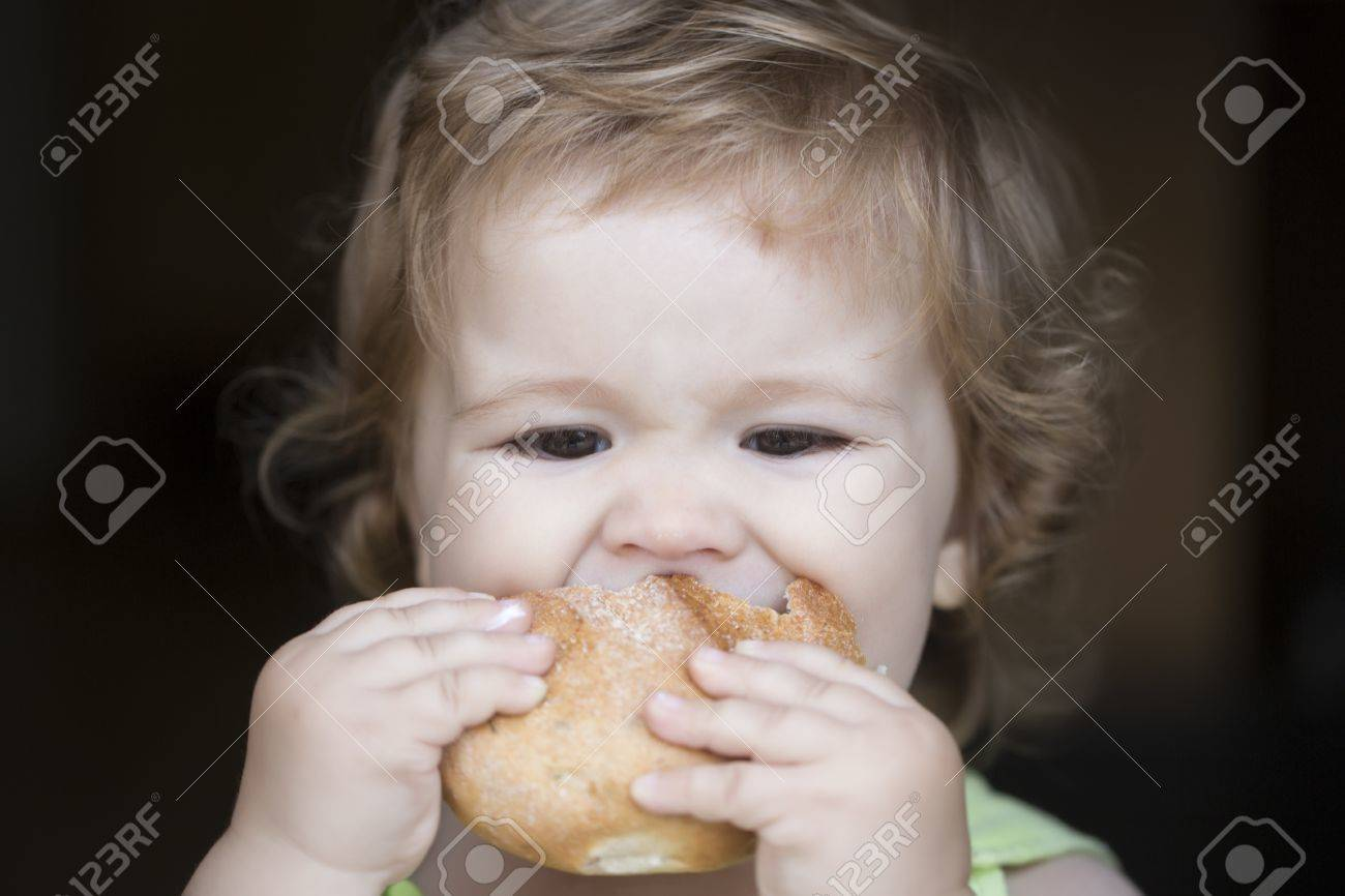 Hungry Little Cute Baby Boy With Blonde Curly Hair Holding And Stock Photo Picture And Royalty Free Image Image 42754418