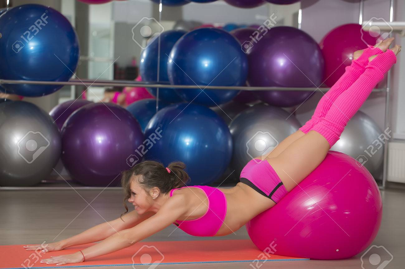 Beautiful Flexible Sexy Fitness Girl With Musculat Body Lying On Floor On Mat Stretching And Gliding