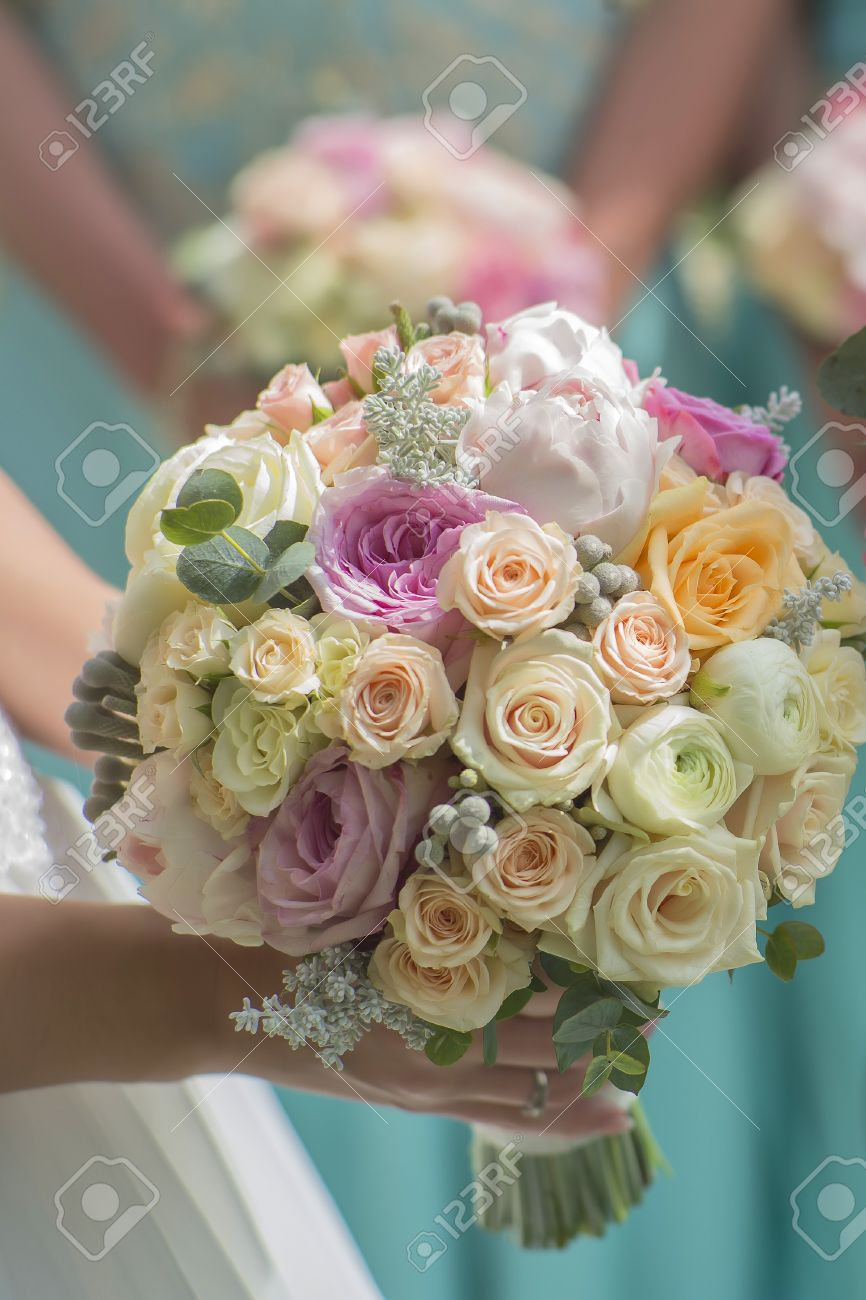 Closeup Of Beautiful Fresh Wedding Bouquet Of Colorful Rose Flowers