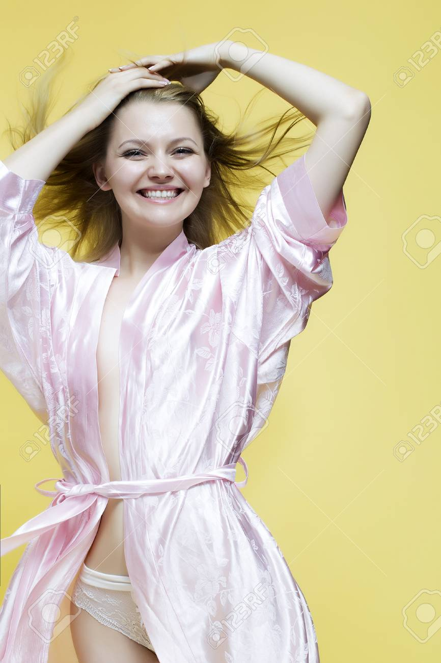 Blond Beautiful Young Lovely Laughing Lady In Satin Pink Dressing ...