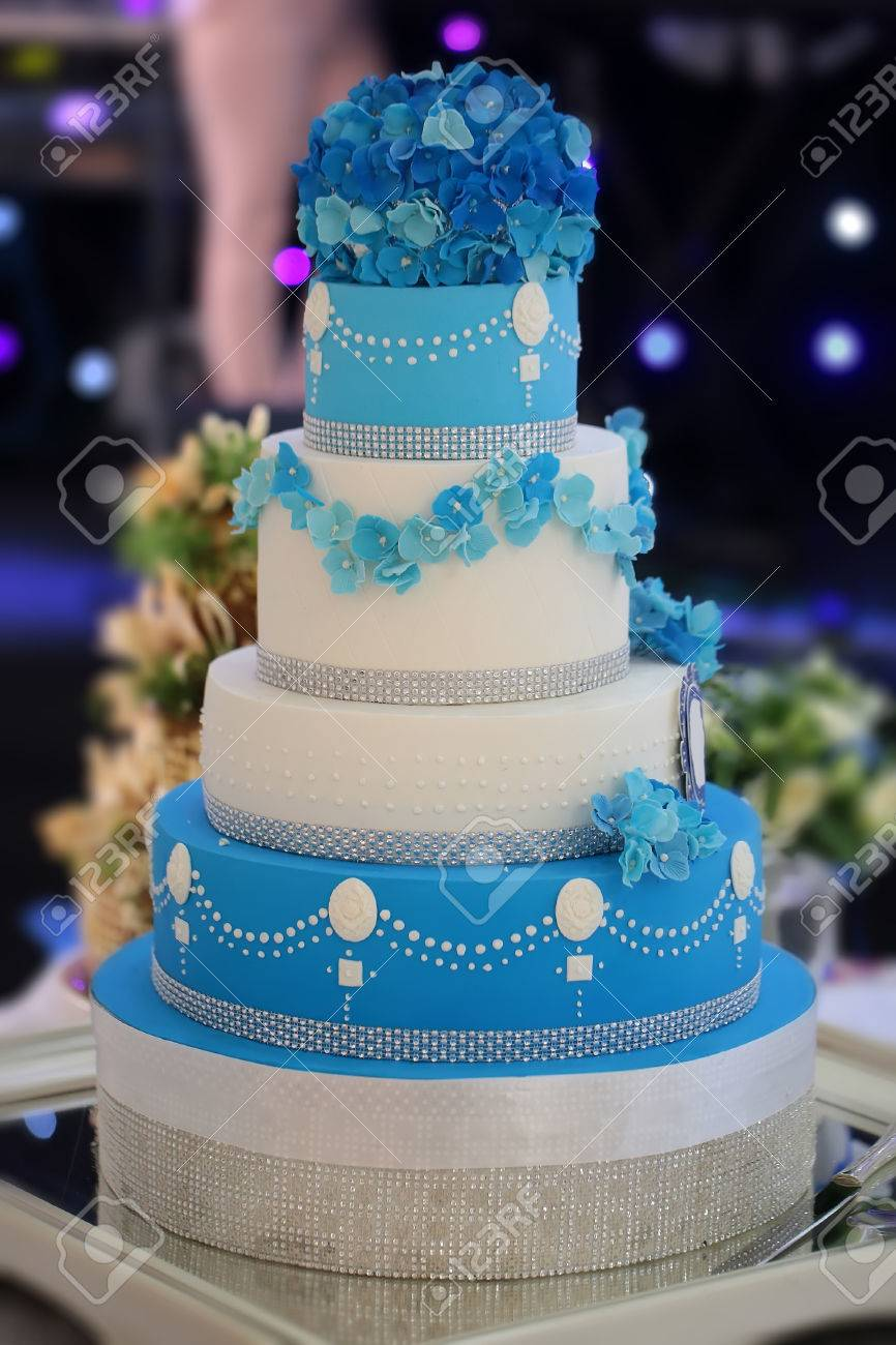One big beautiful tasty many tier decorated wedding cake white one big beautiful tasty many tier decorated wedding cake white and blue colours with flower izmirmasajfo Images