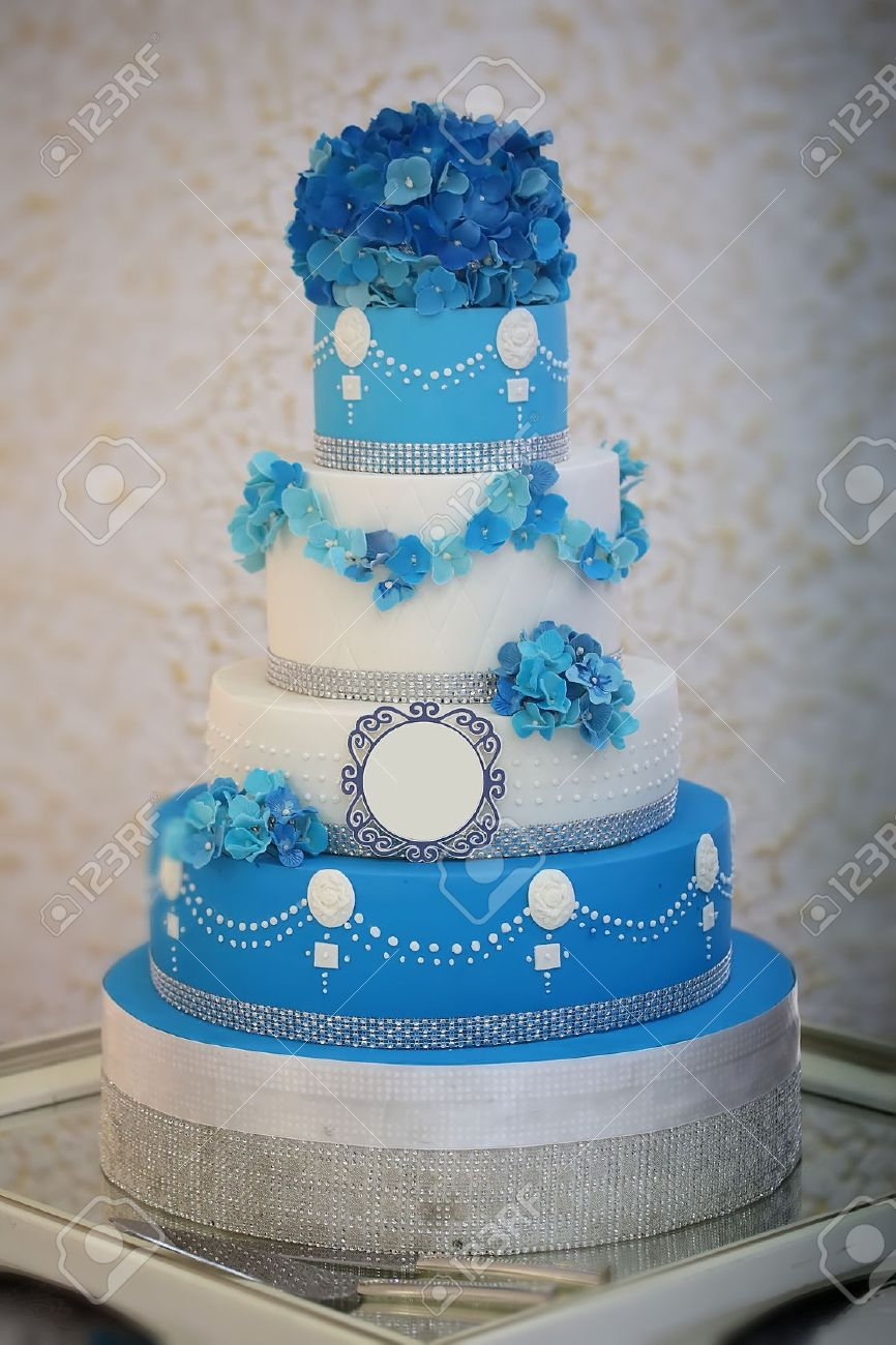 One large beautiful delicious many tier decorated wedding cake one large beautiful delicious many tier decorated wedding cake white and blue colours with flower izmirmasajfo