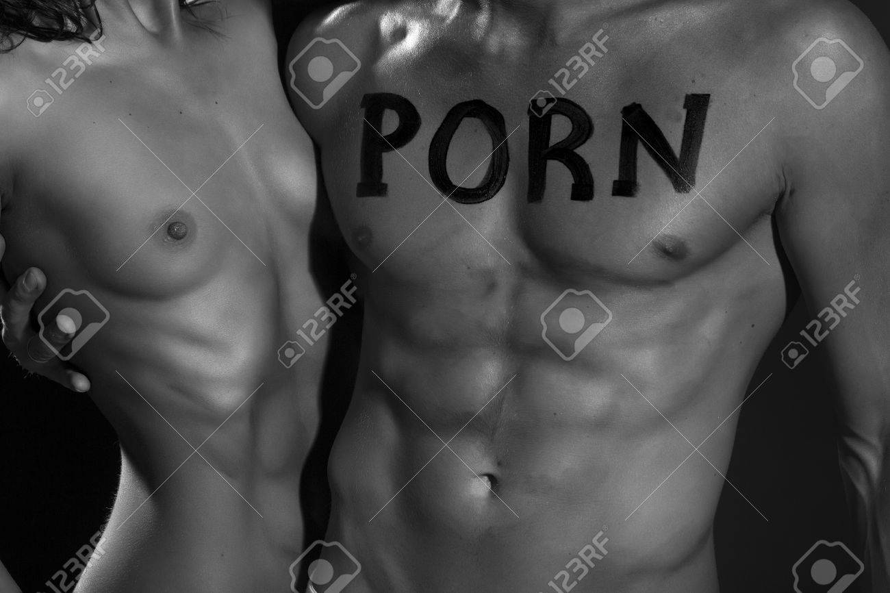 Sexy Young Naked Couple Of Muscular Boy With Porn Text On Chest And Girl With Straight