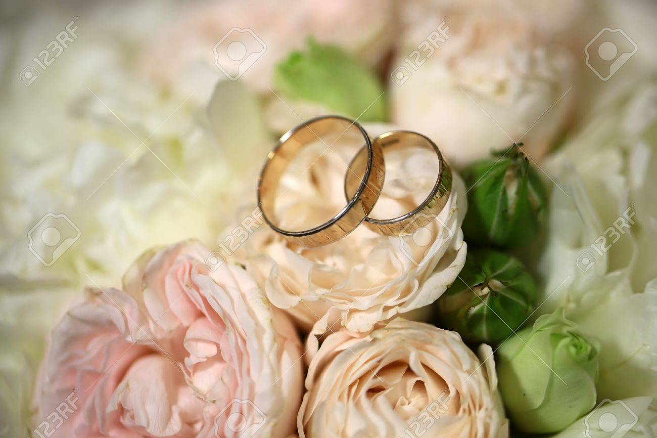 Closeup view of beautiful fresh soft wedding decorative bouquet of pink rose white peony and green flowers with two golden rings, horizontal picture - 46562509