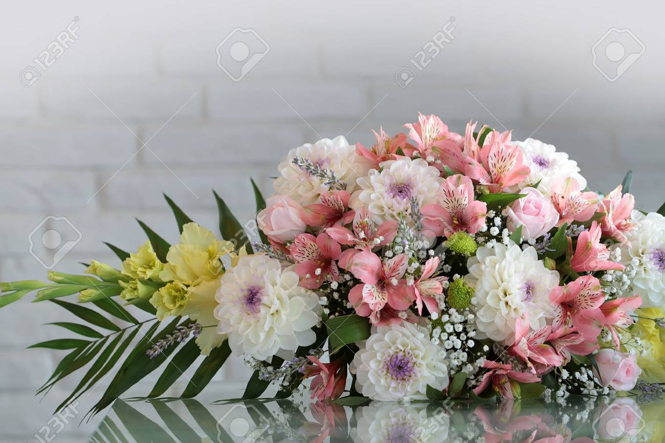 Closeup Beautiful Bunch Of Fresh Tender Flowers In White And Stock