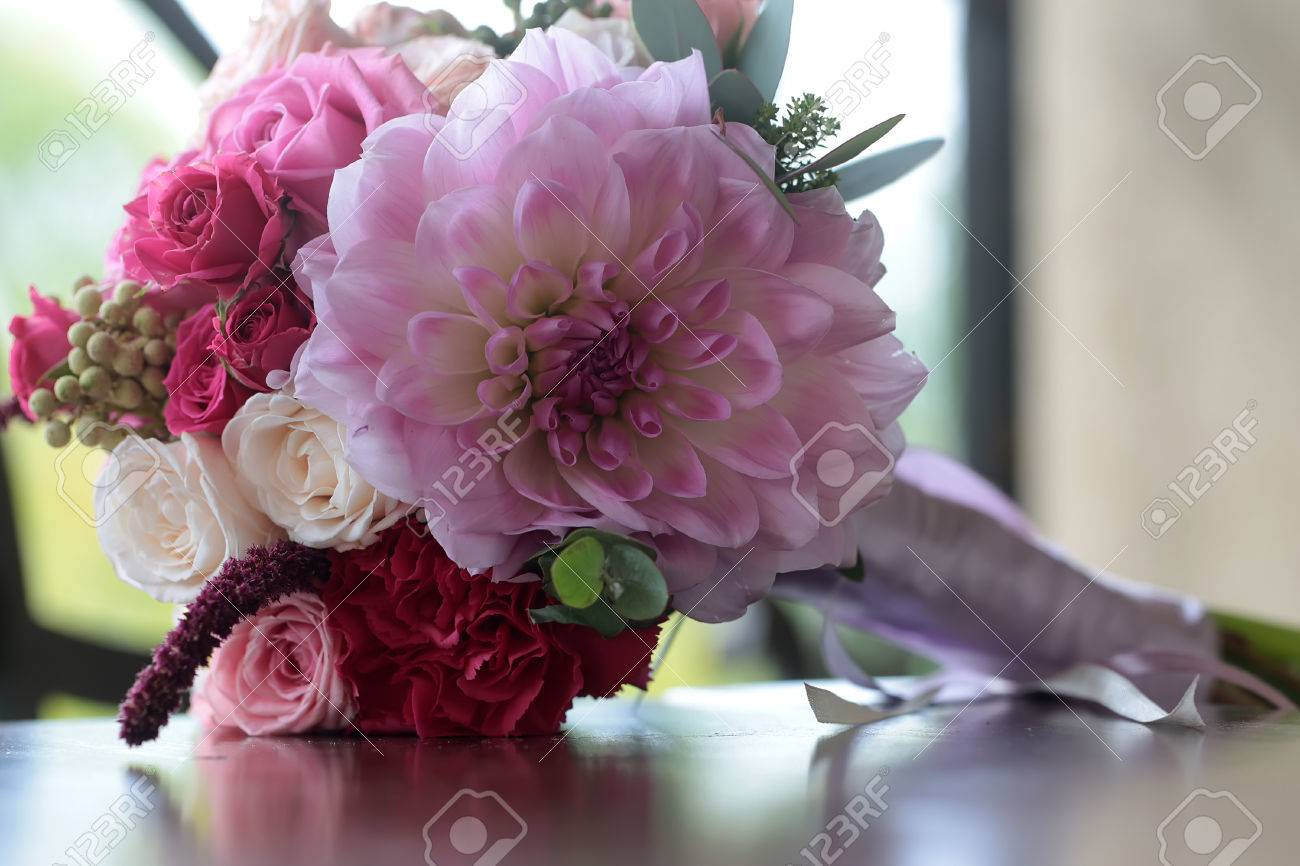 Closeup View Of One Beautiful Fresh Colorful Mixed Wedding Bouquet