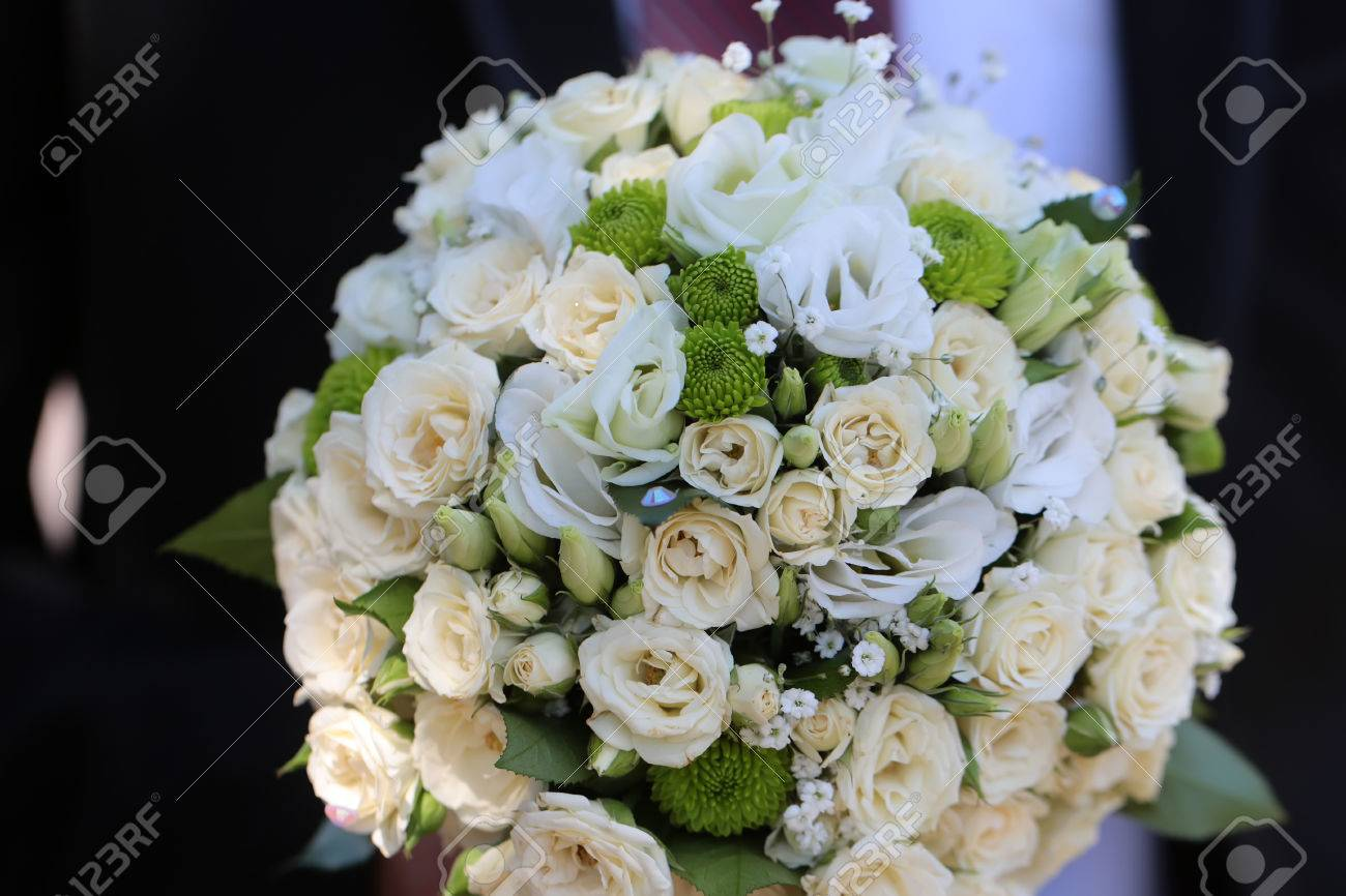 Splendid wedding bridal bouquet of champagne white colored roses splendid wedding bridal bouquet of champagne white colored roses and green flowers marry celebration anniversary day izmirmasajfo