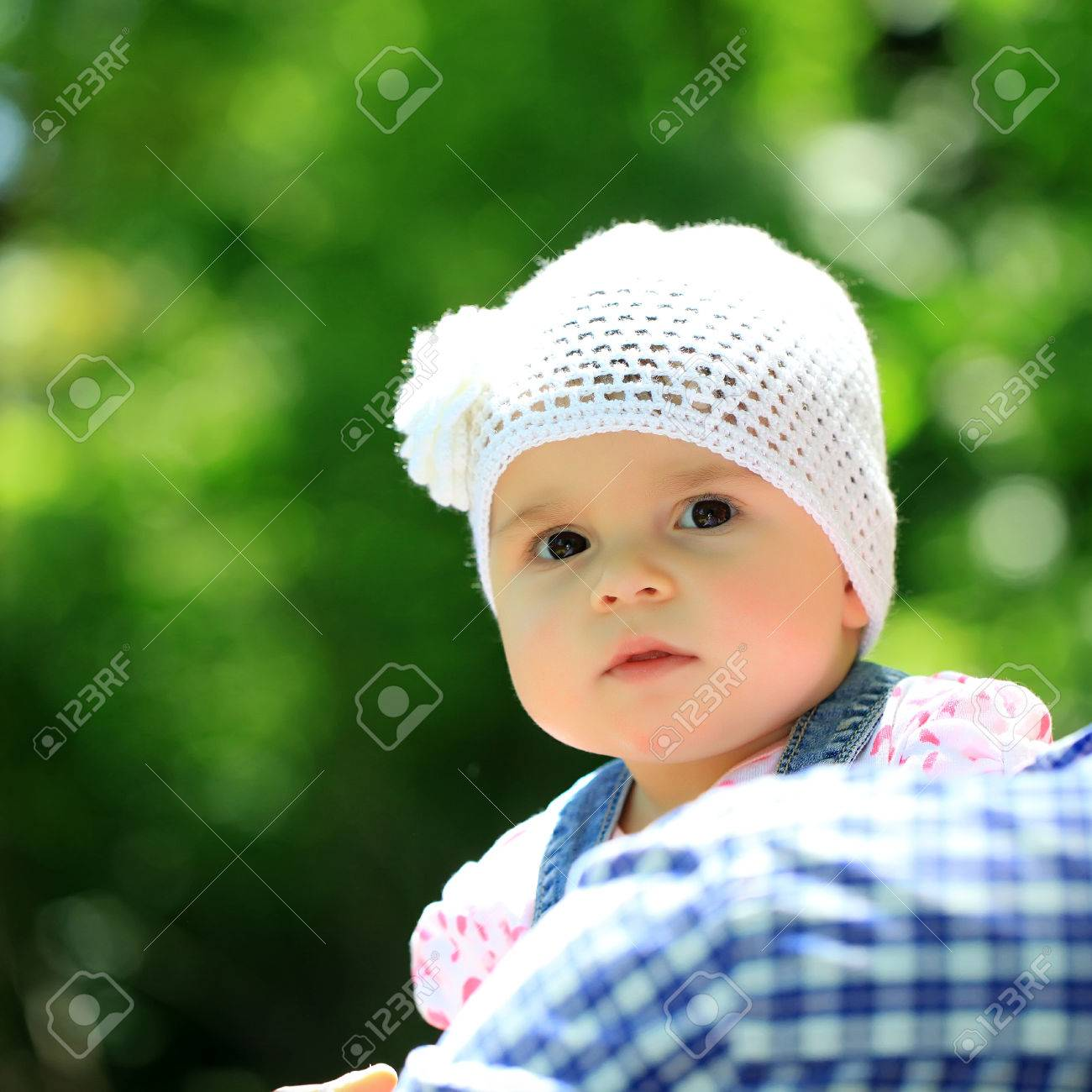 2a028b368 Baby girl cute hazel-eyed kid tiny little child wearing white..