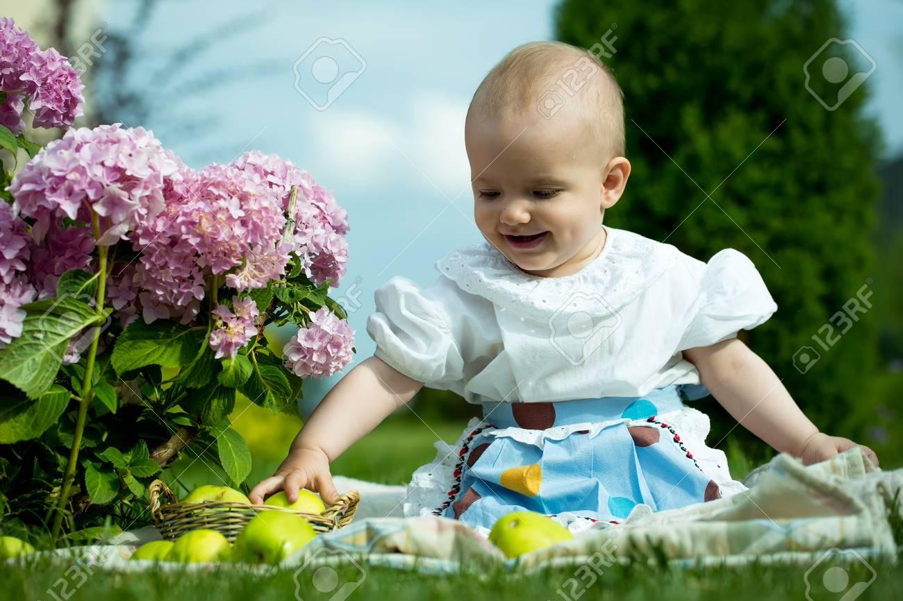 f21ef16b2e60 Happy Smiling Funny Small Baby Girl In Stylish Dress Sitting.. Stock ...