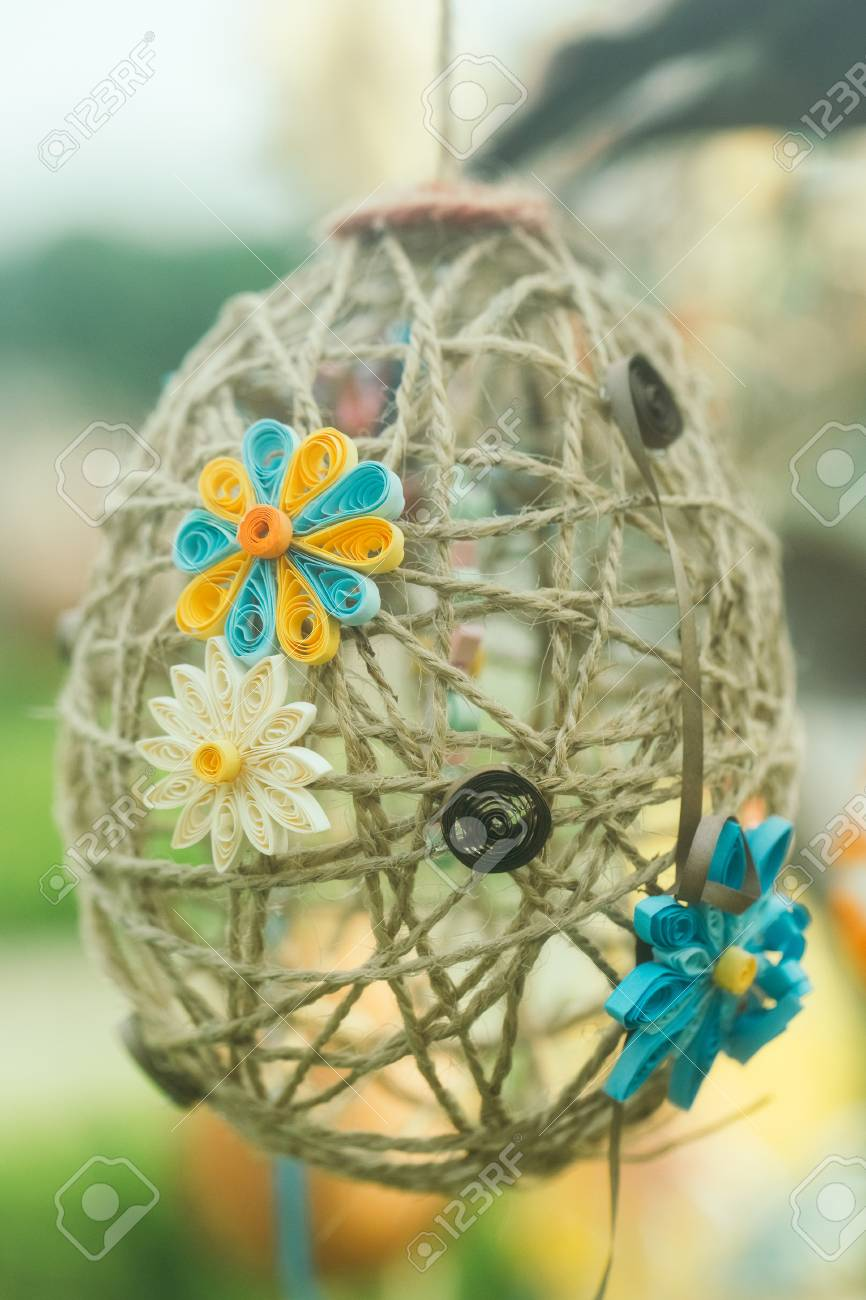 Glue Yarn Easter Egg Decorated With Paper Flowers In Quilling Beautiful Handmade On Blurred Background Stock