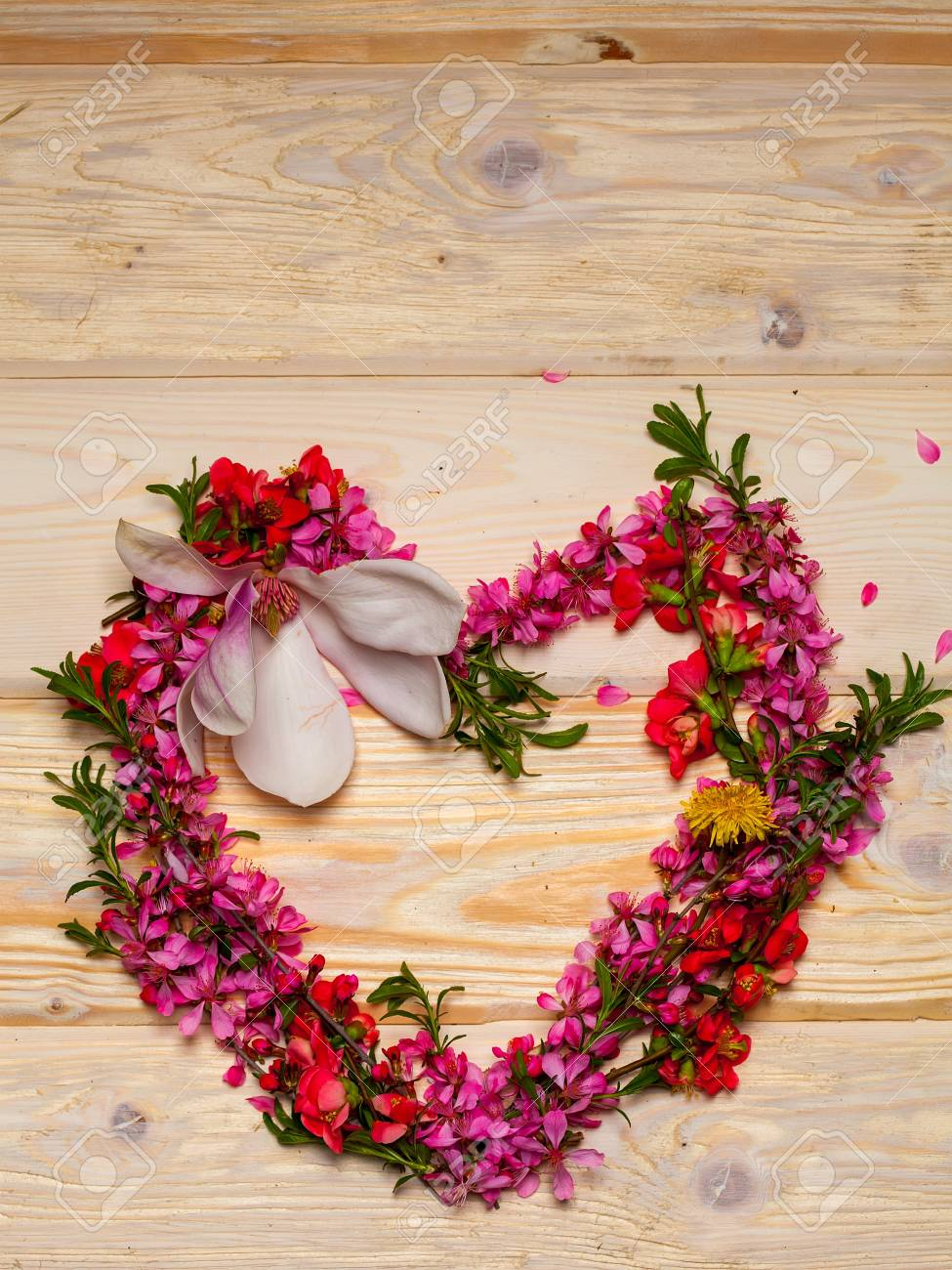 Beautiful flowers in heart shape on wooden background stock photo beautiful flowers in heart shape on wooden background stock photo 58481370 izmirmasajfo