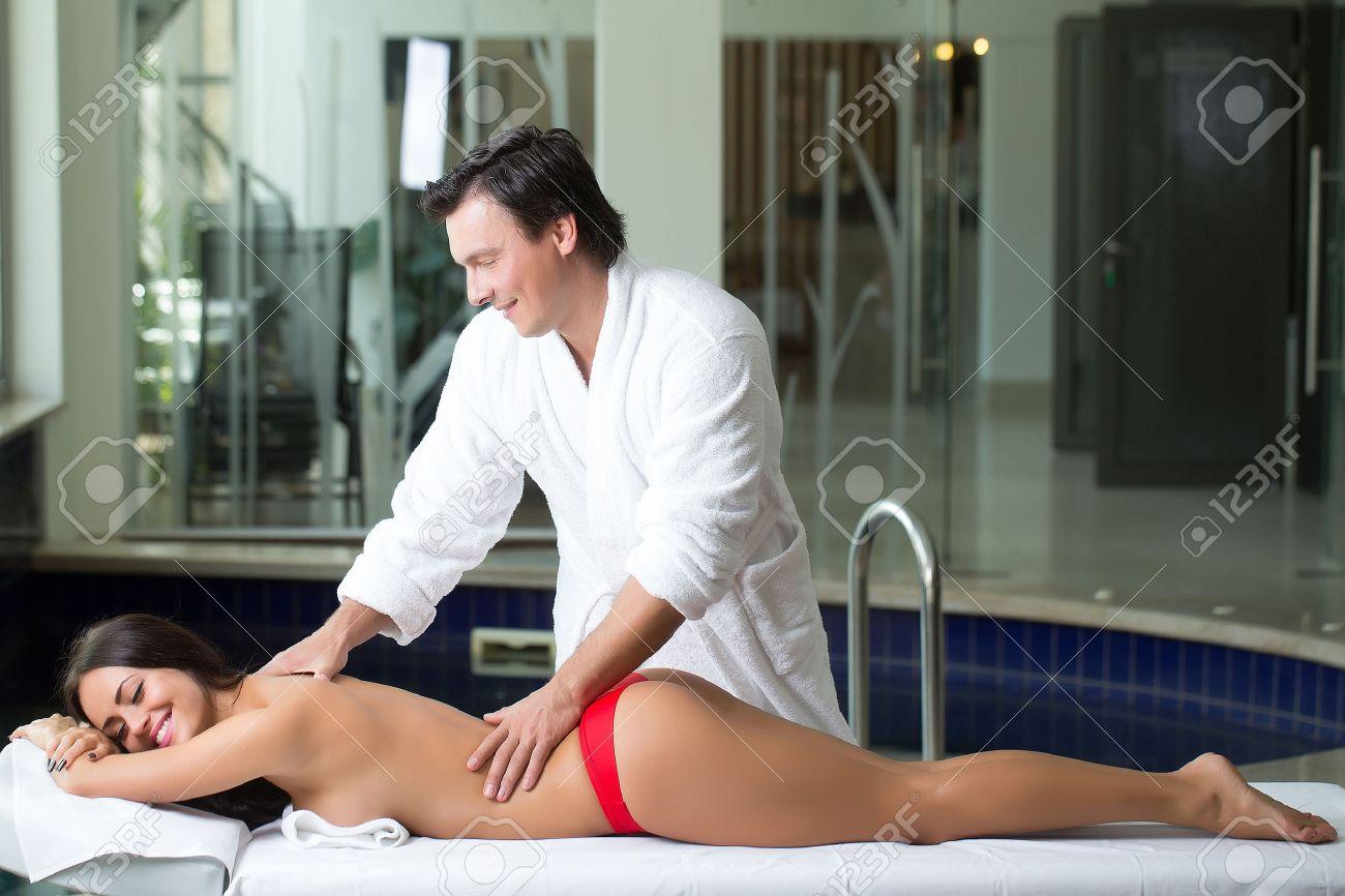 mature woman massaging nude man