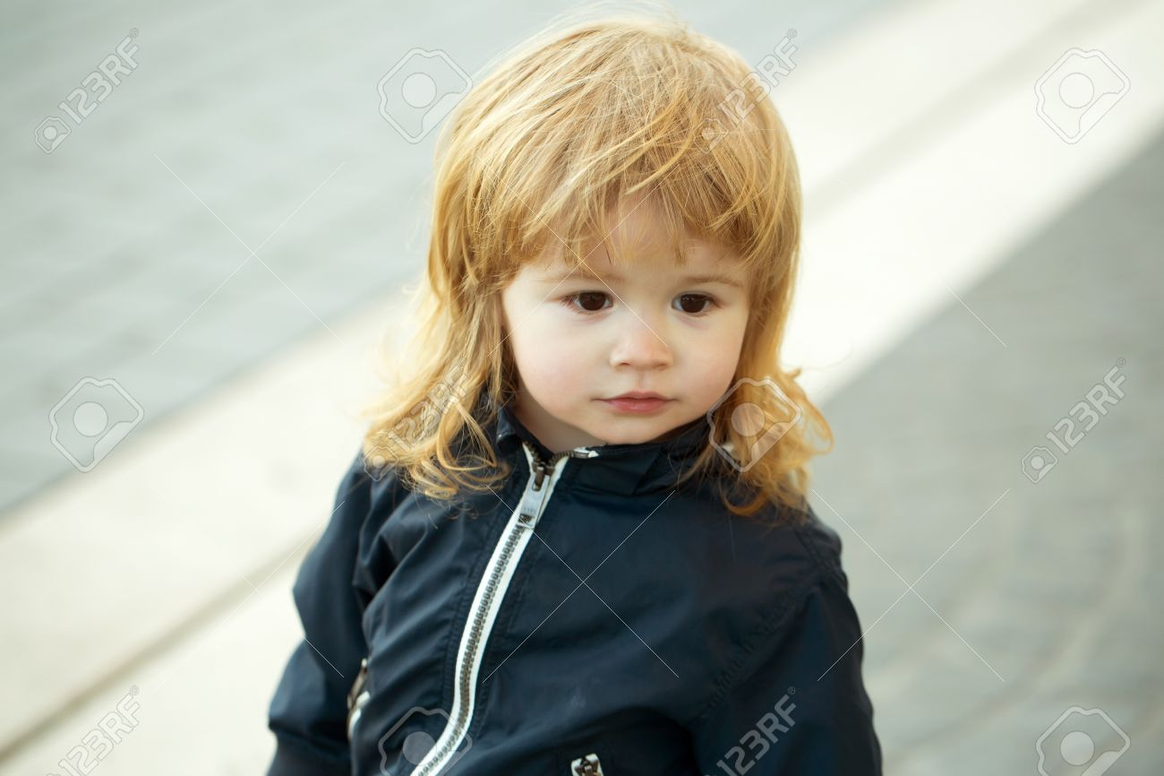 Little Boy With Pretty Cute Face Brown Eyes And Blond Curly Long