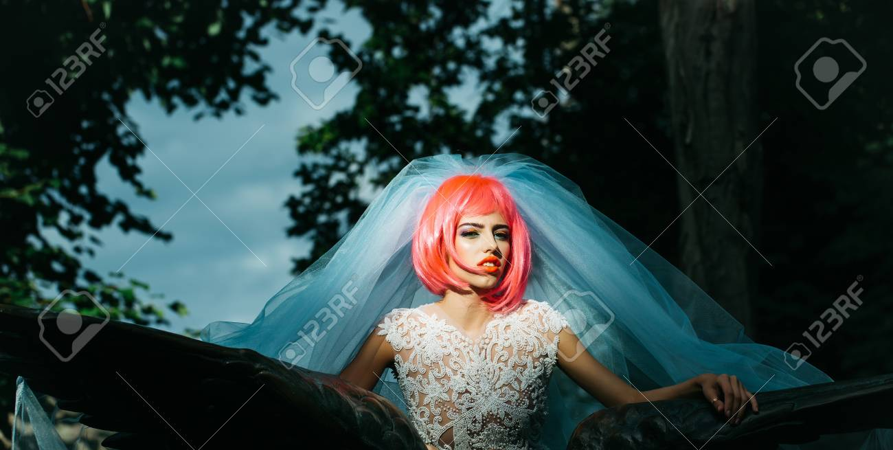 Young Pretty Woman With Orange Or Pink Hair And Bright Makeup ...